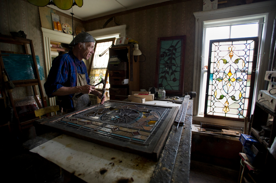 Peter Ureneck (CGS'69) at his home and in his workspace in Dorchester July 9, 2013.  Photo by Cydney Scott for Boston University Photography