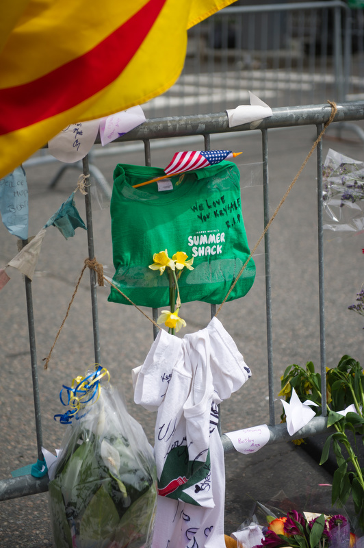 Scenes from the make-shift memorial by the barricades blocking off Boylston Street at Hereford Street April 20, 2013.