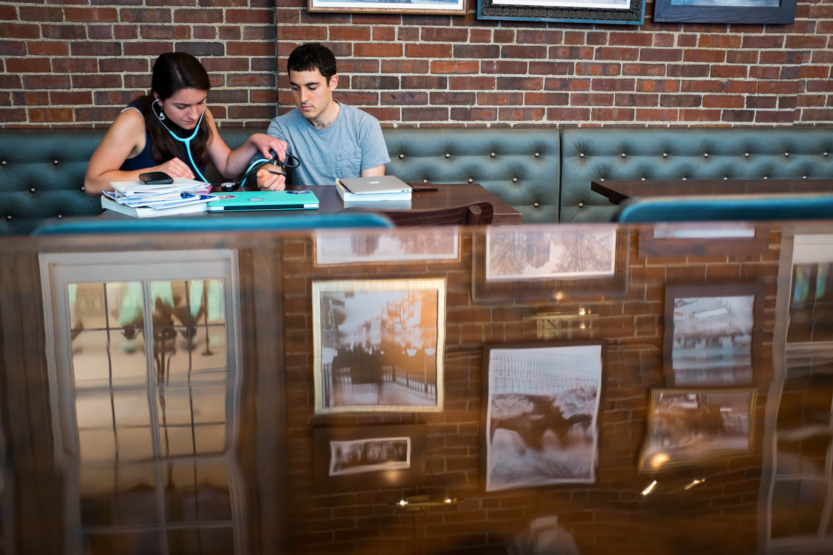 These two were studying together in the student union where a table carved into in 1909 stayed shiny with an epoxy coating.