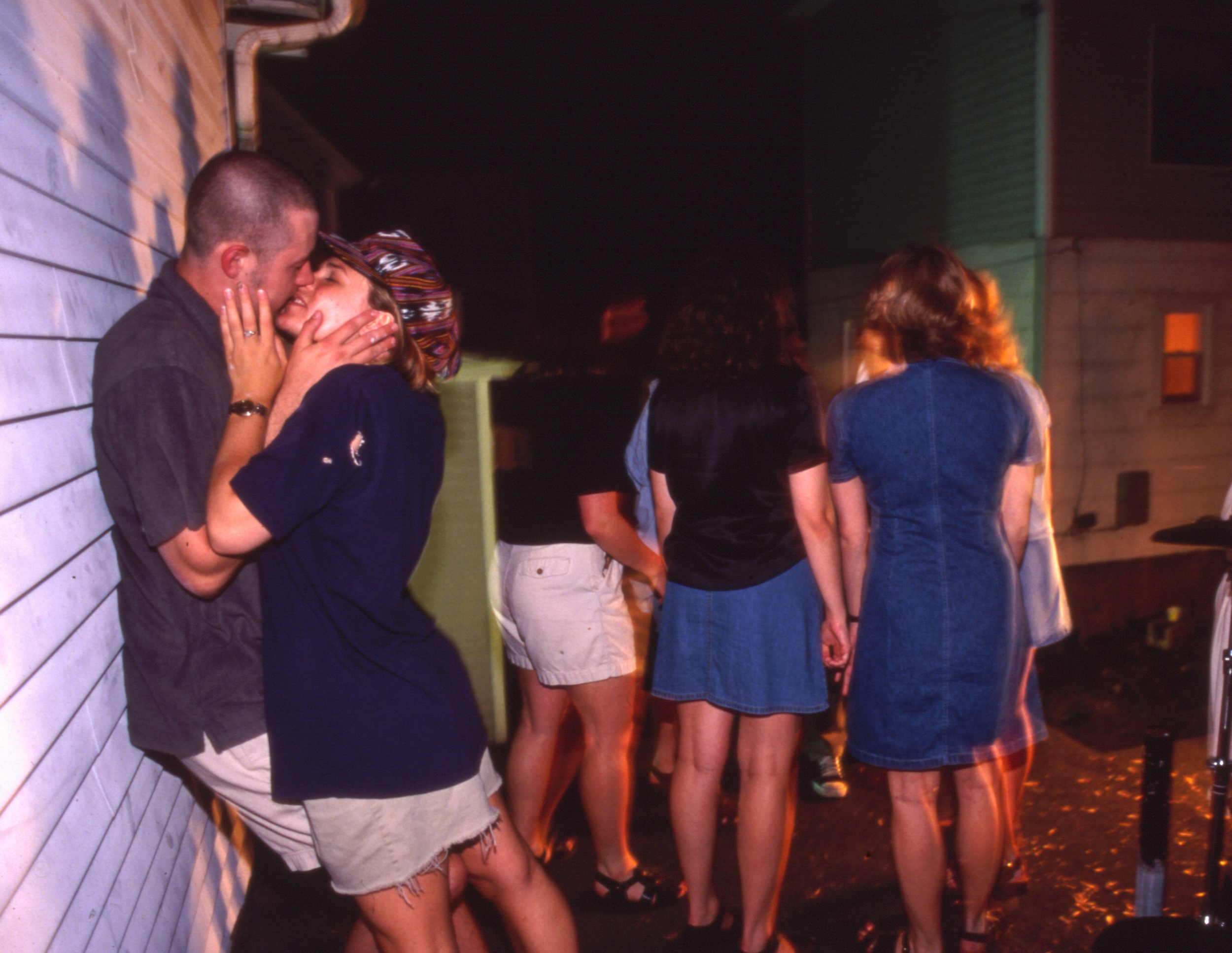 Suzanne and Joe lock lips, 1997
