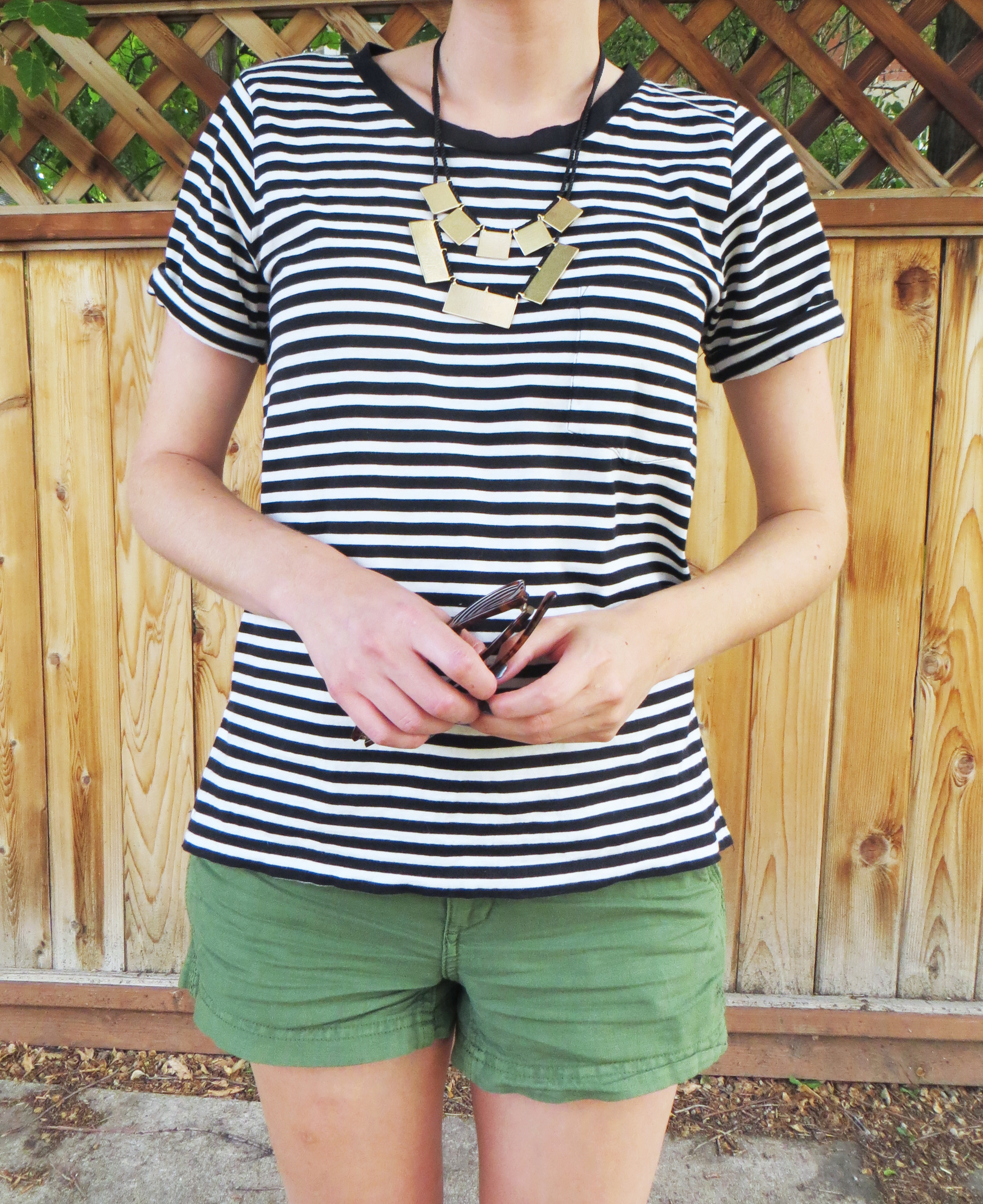 Rectangular necklace, striped tee, green shorts -- Cotton Cashmere Cat Hair