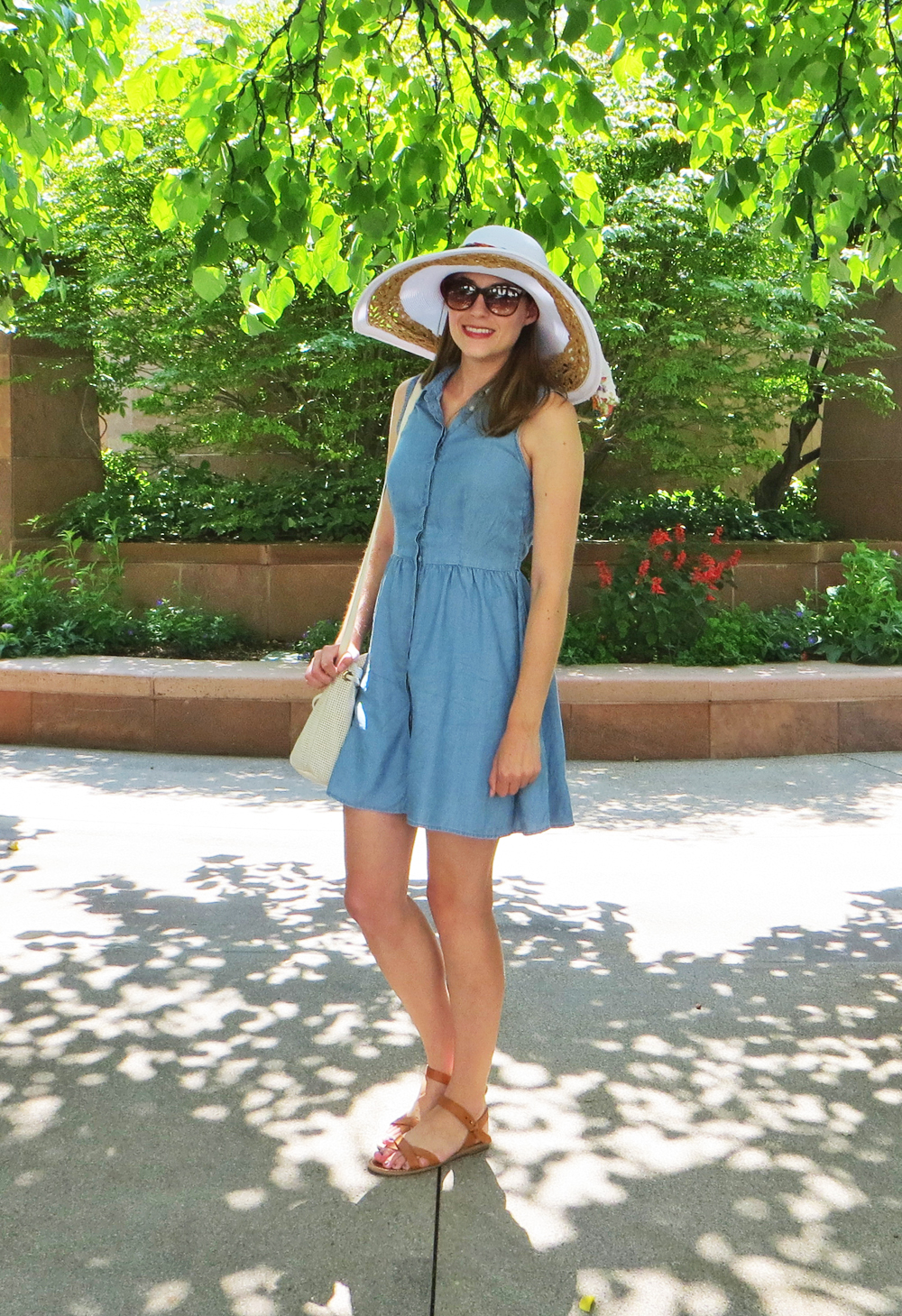 Chambray shirtdress, tan sandals, leather bucket bag, white sun hat, floral scarf -- Cotton Cashmere Cat Hair