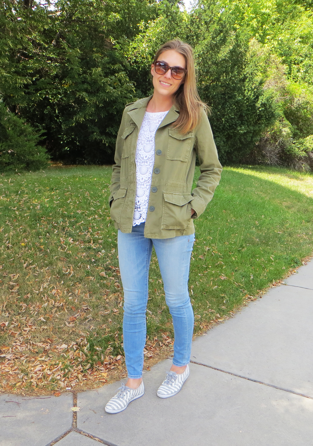 Army green jacket, white crocheted top, light wash denim, striped Keds -- Cotton Cashmere Cat Hair