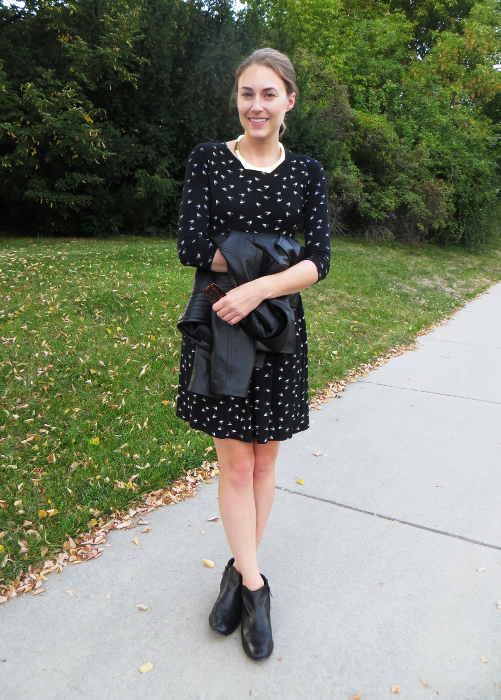 Bird-print dress, black ankle boots, gold choker, leather jacket -- Cotton Cashmere Cat Hair