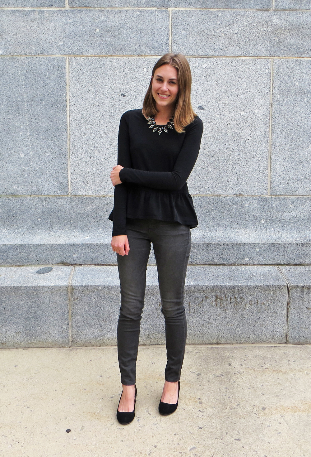 Black peplum top, grey skinny jeans, black wedges, black statement necklace -- Cotton Cashmere Cat Hair