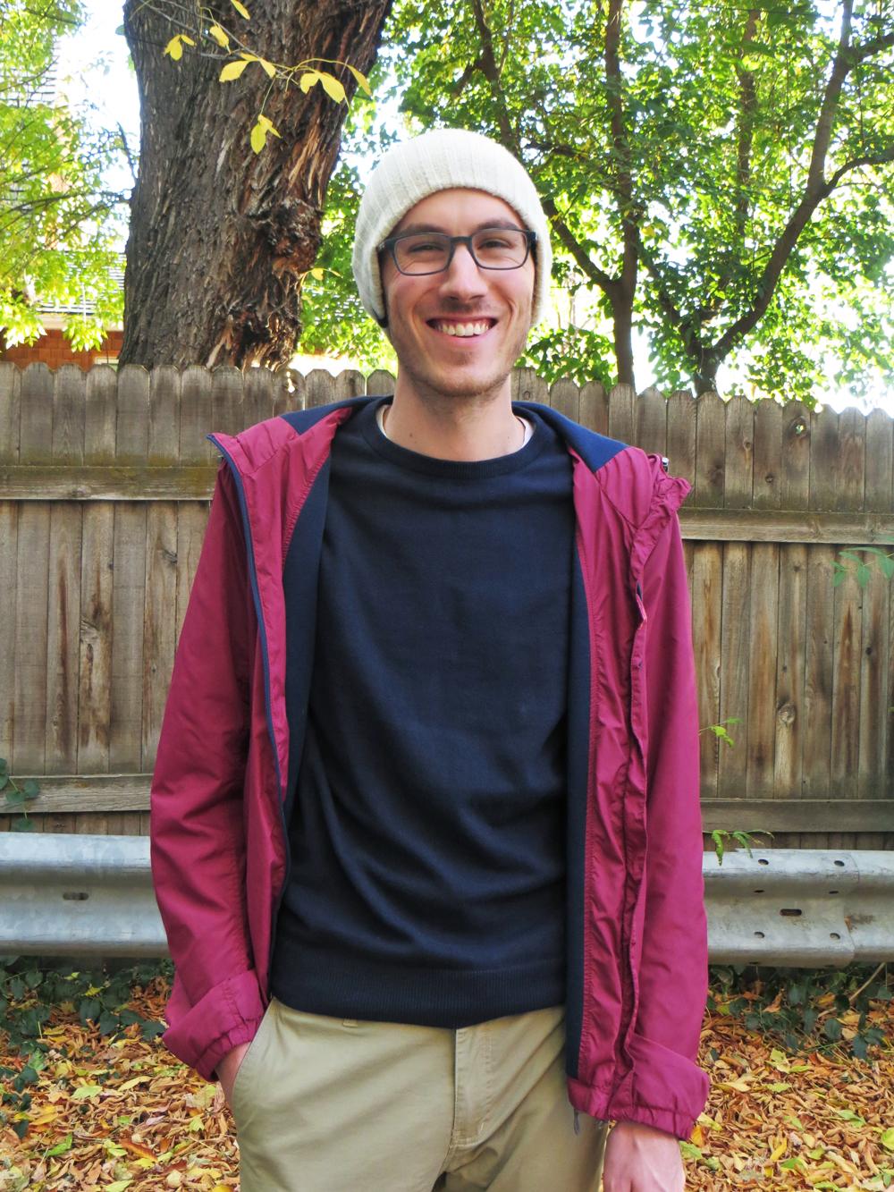 His grad student style: Burgundy light jacket, navy sweater, khaki pants, beanie -- Cotton Cashmere Cat Hair