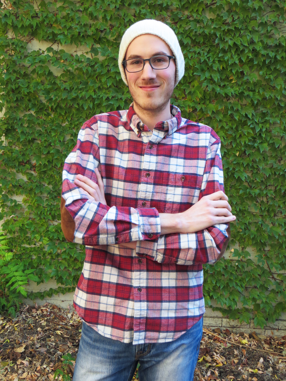 His grad student style: Plaid workshirt, skinny jeans, beanie -- Cotton Cashmere Cat Hair