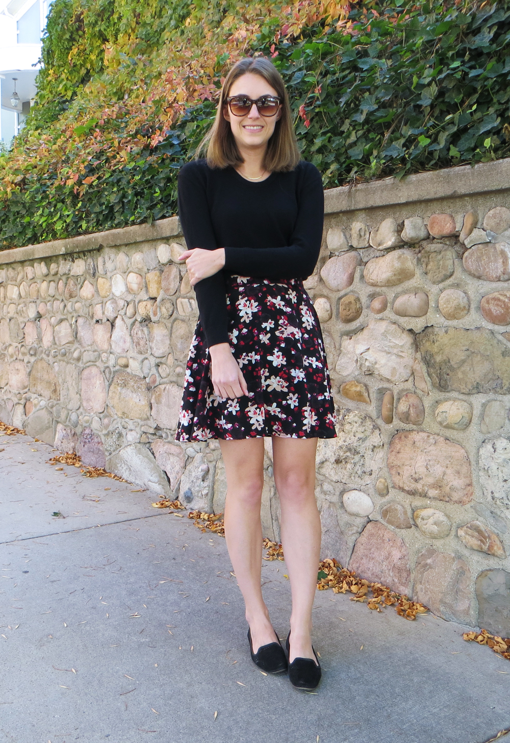 Black sweater, dark floral skirt, black loafers, simple necklace -- Cotton Cashmere Cat Hair