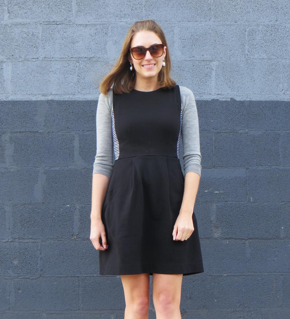 Light grey sweater, black dress, statement earrings -- Cotton Cashmere Cat Hair
