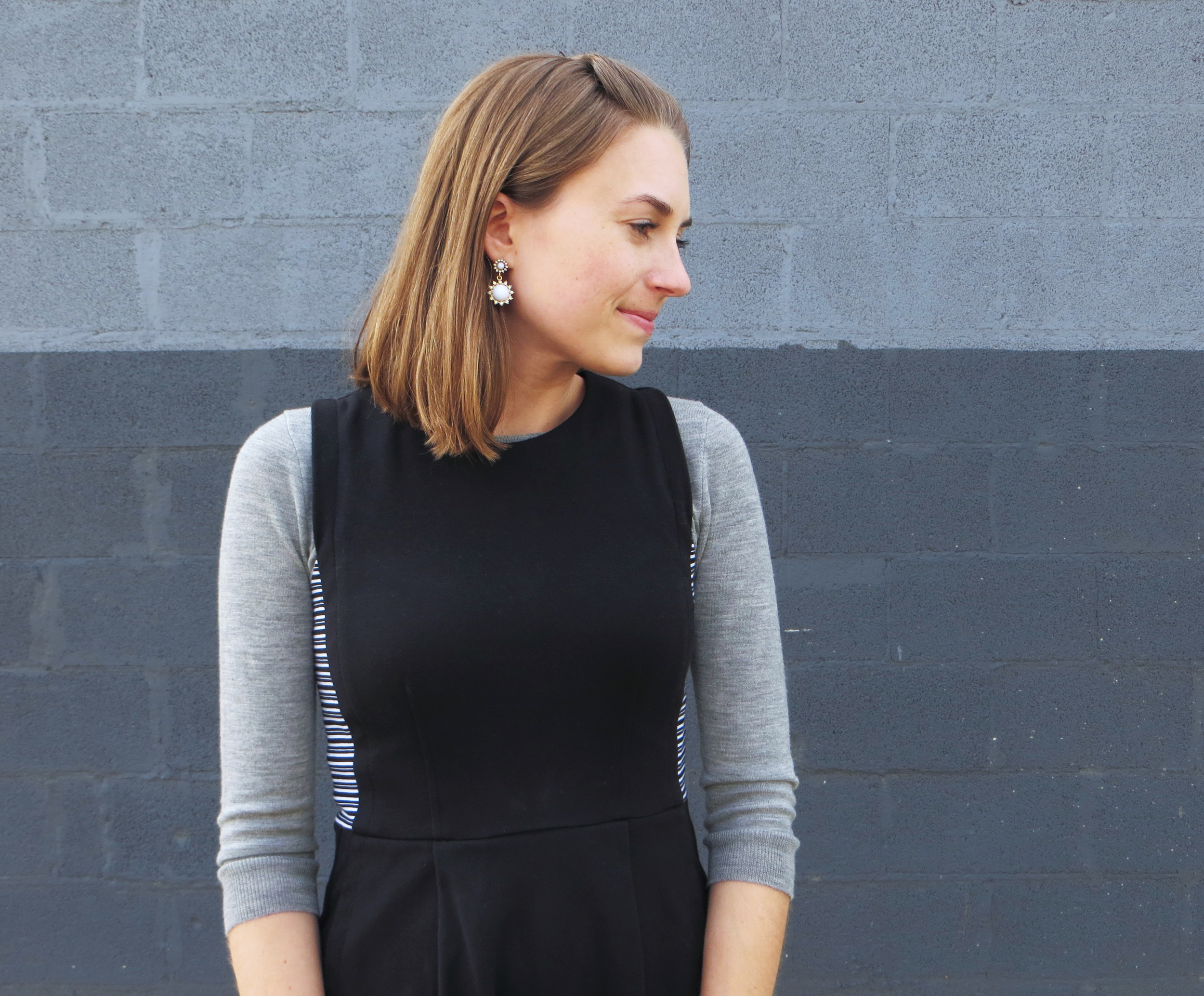 Sweater layered under dress + statement earrings -- Cotton Cashmere Cat Hair