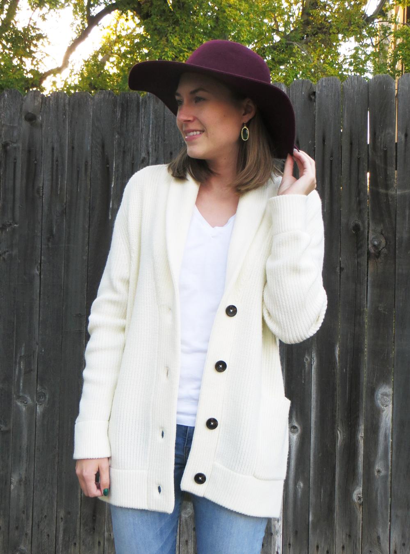 Burgundy felt hat, emerald green Kendra Scott earrings, Everlane knit cardigan and tee -- Cotton Cashmere Cat Hair