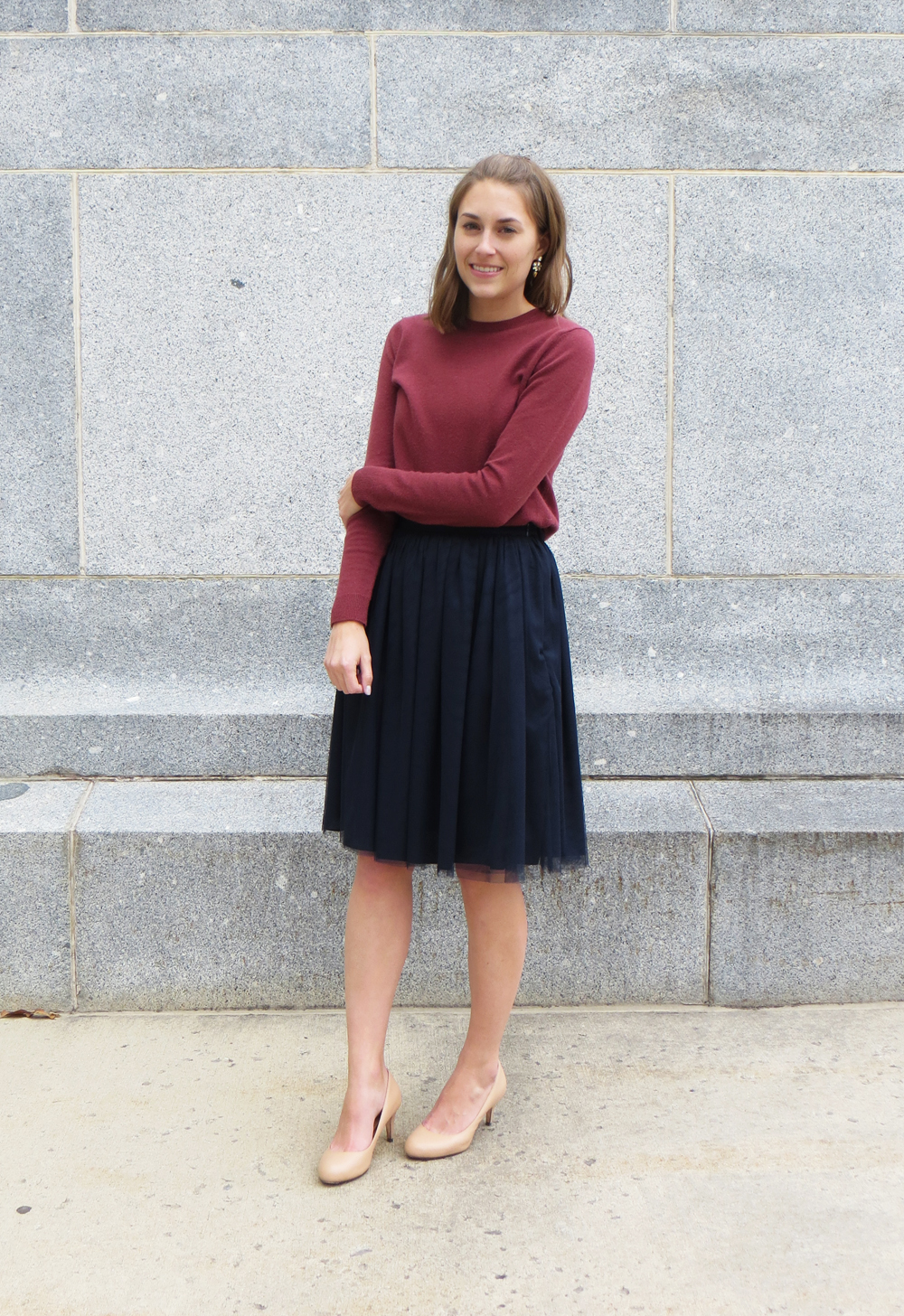 Marsala cashmere sweater, navy tulle skirt, nude pumps, crystal statement earrings — Cotton Cashmere Cat Hair