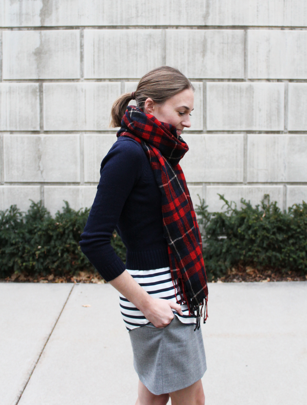 Plaid scarf, cropped navy sweater, navy striped top, grey mini skirt — Cotton Cashmere Cat Hair