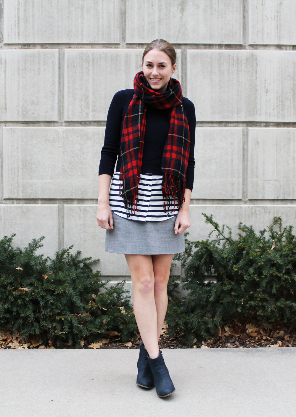 Red plaid scarf, navy cropped sweater, navy striped top, grey mini skirt, navy ankle boots — Cotton Cashmere Cat Hair