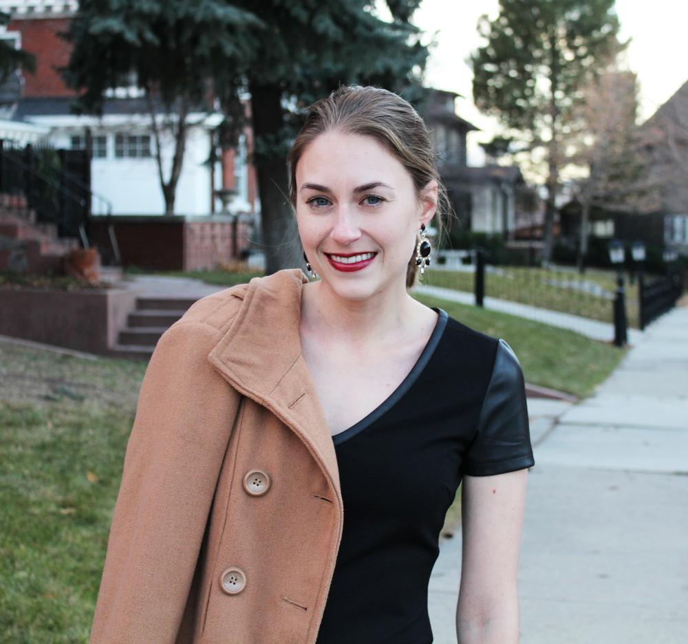 Camel coat + black dress w/ faux-leather details + statement earrings — Cotton Cashmere Cat Hair