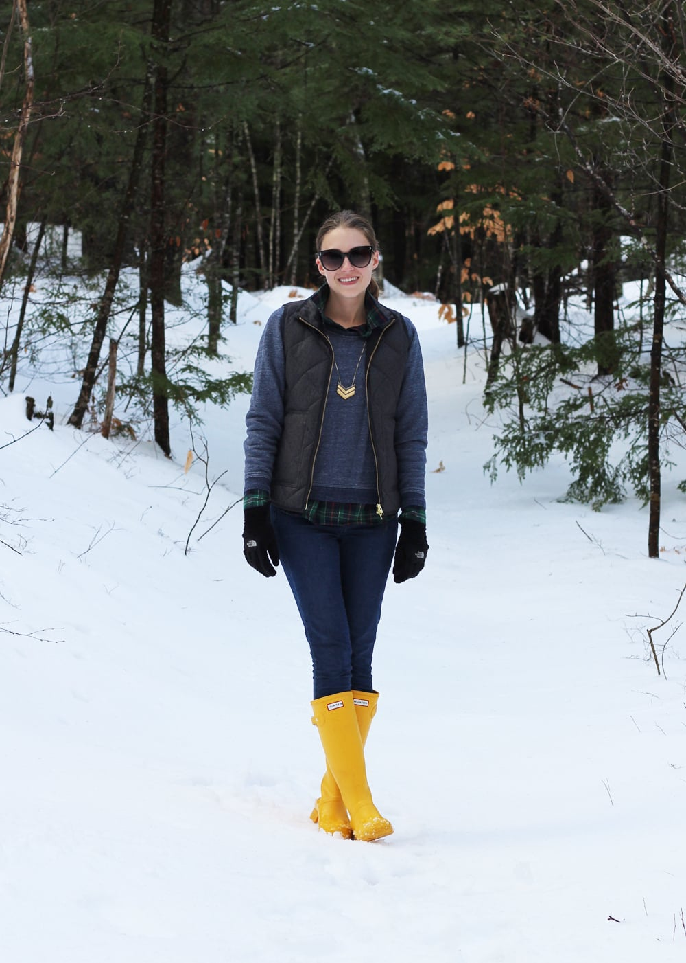 Grey puffer vest, navy sweatshirt, flannel shirt, skinny jeans, Hunter boots — Cotton Cashmere Cat Hair
