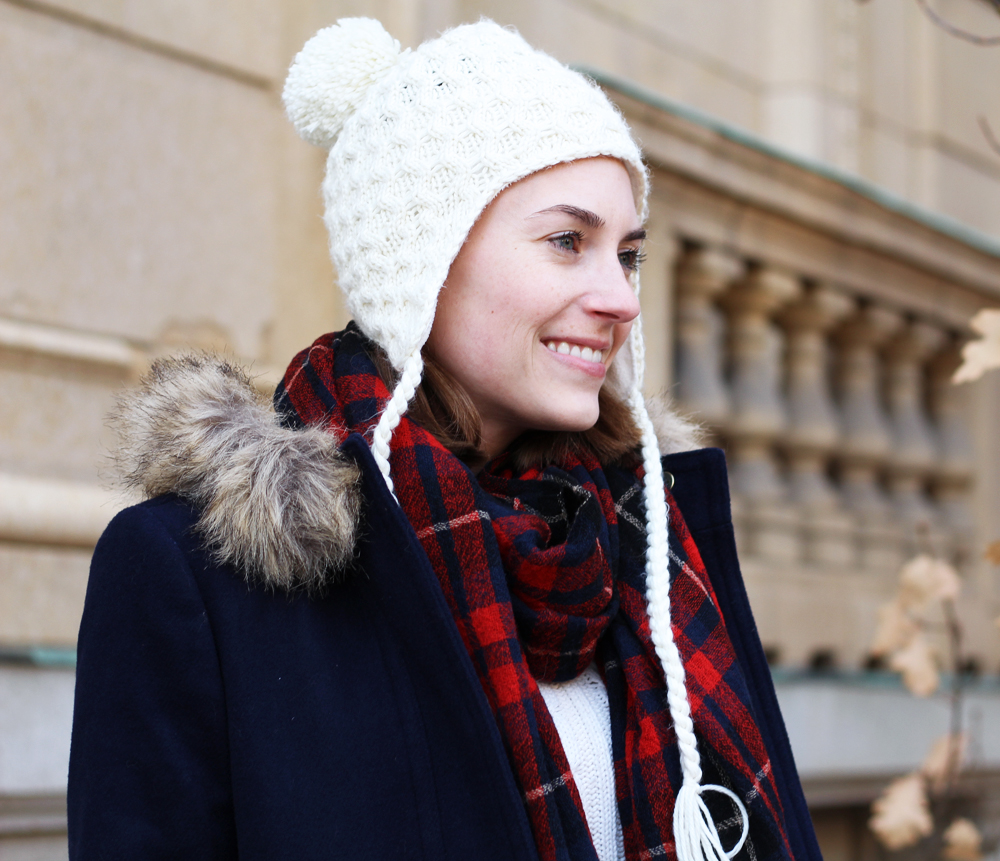 Ivory beanie, red plaid scarf, navy coat, ivory sweater — Cotton Cashmere Cat Hair