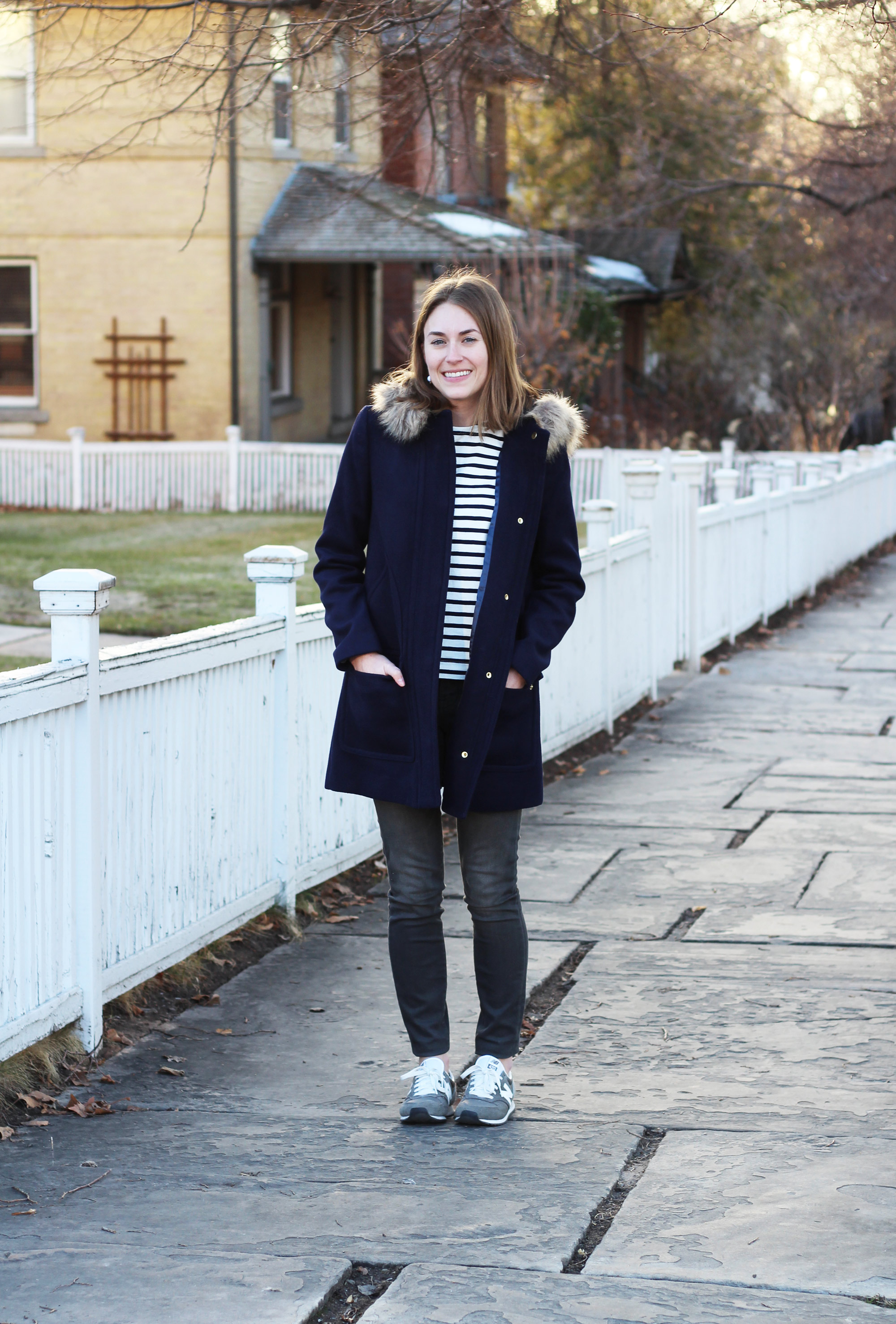 Navy parka, striped tee, grey skinny jeans, grey New Balance sneakers -- Cotton Cashmere Cat Hair