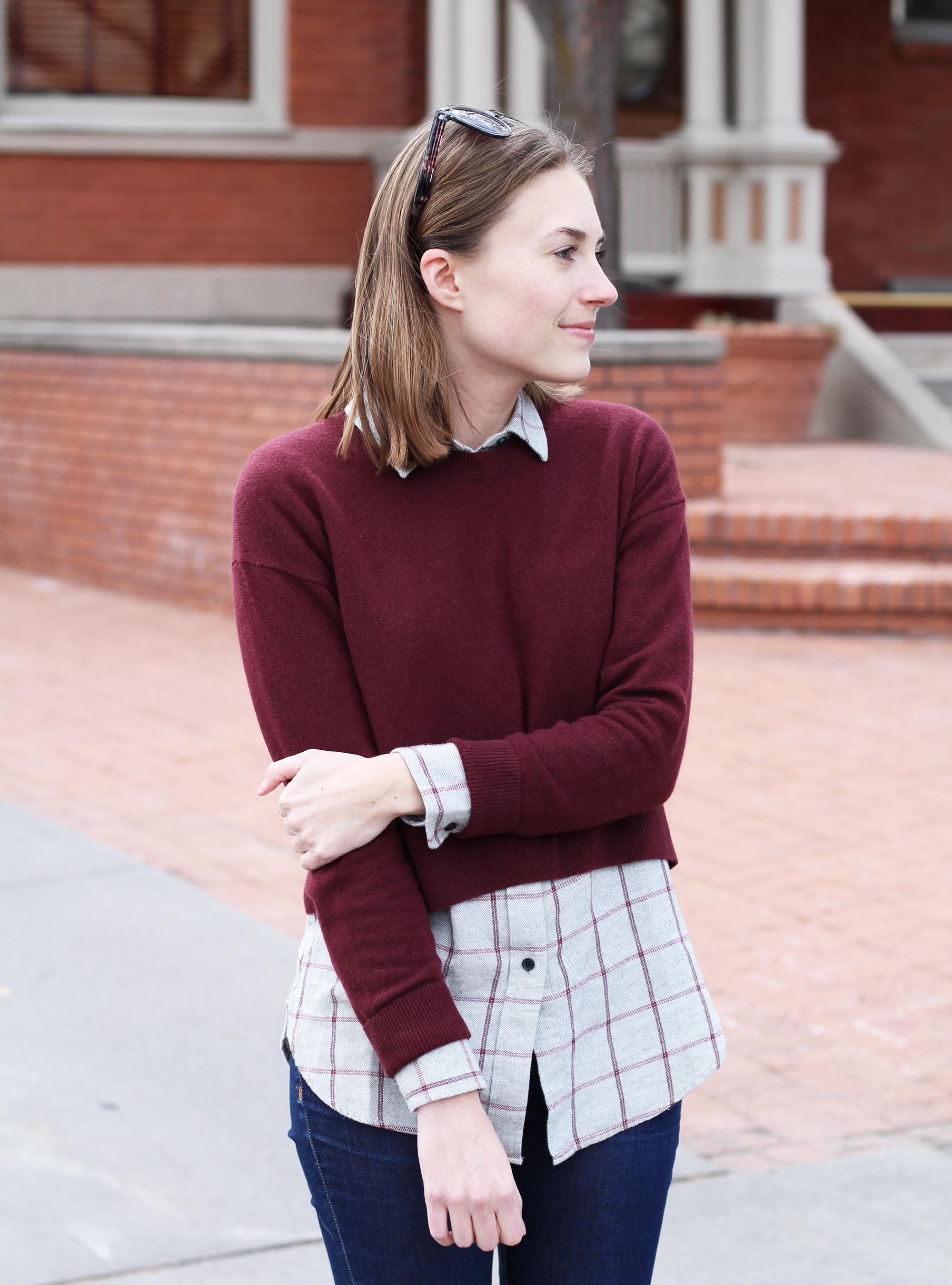 Burgundy cropped sweater over grey plaid flannel shirt -- Cotton Cashmere Cat Hair