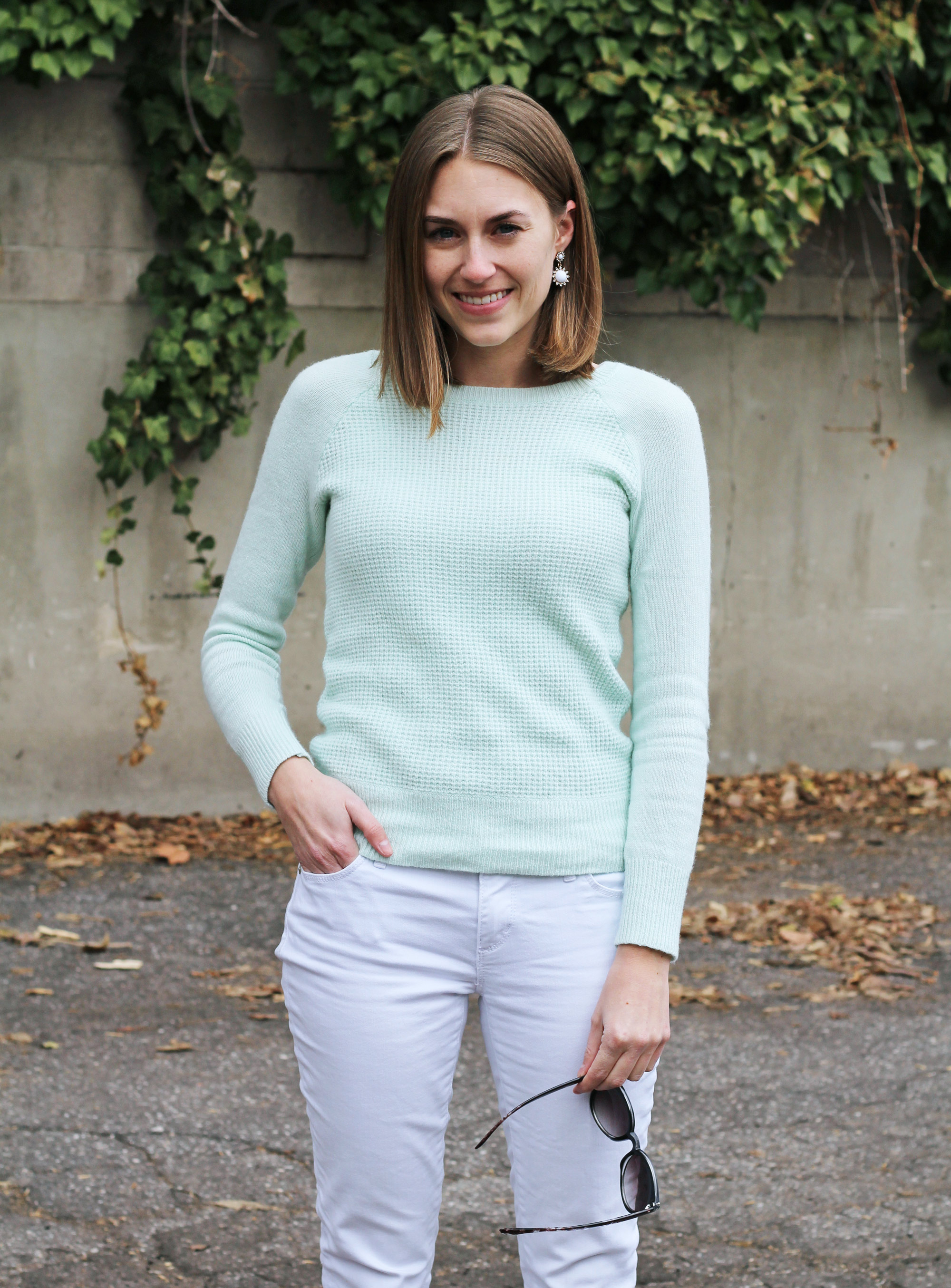 Mint sweater + white skinny jeans + white statement earrings — Cotton Cashmere Cat Hair