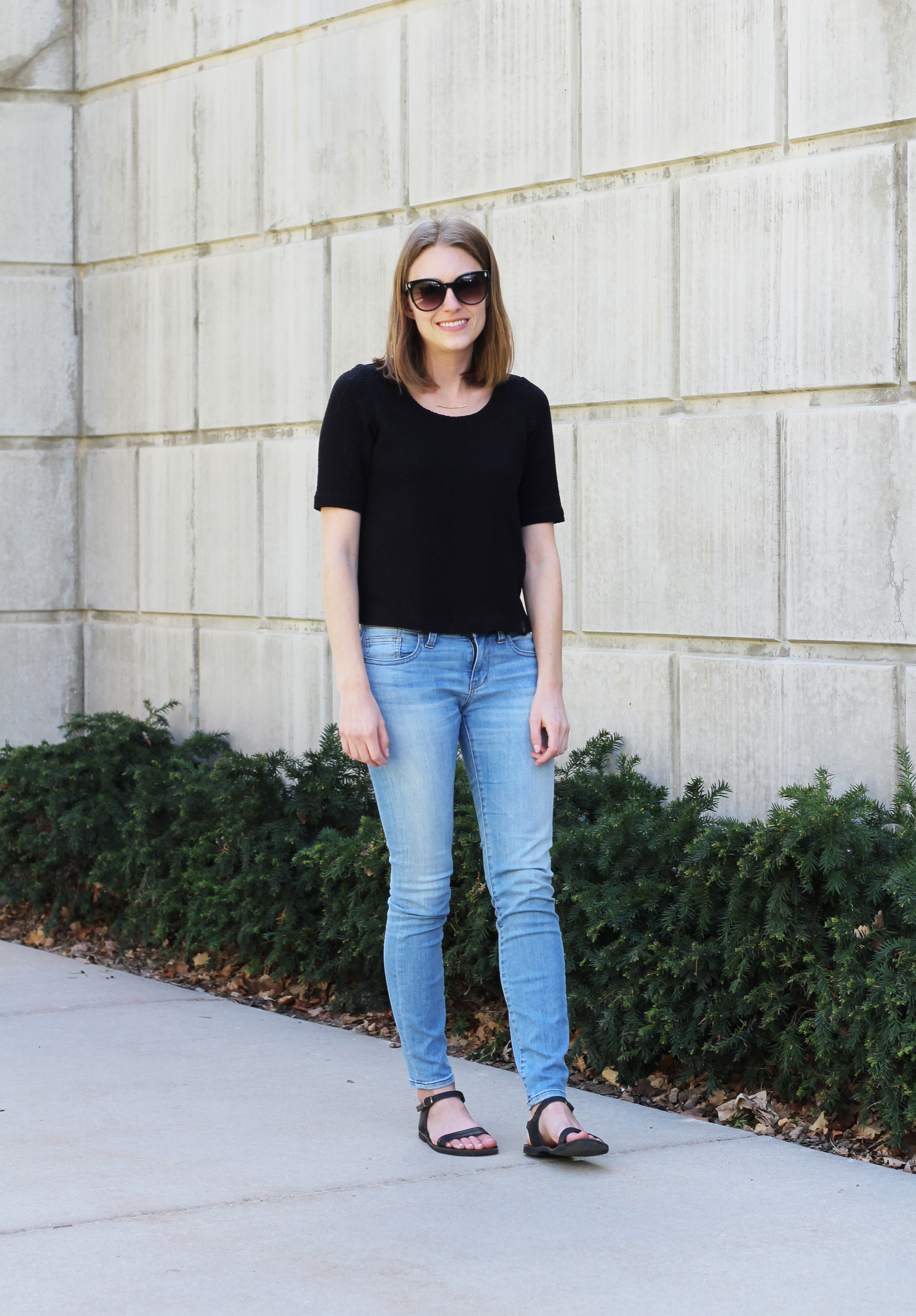 Black Anthropologie top, light wash Madewell skinny jeans, black sandals, gold Gorjana bar necklace — Cotton Cashmere Cat Hair