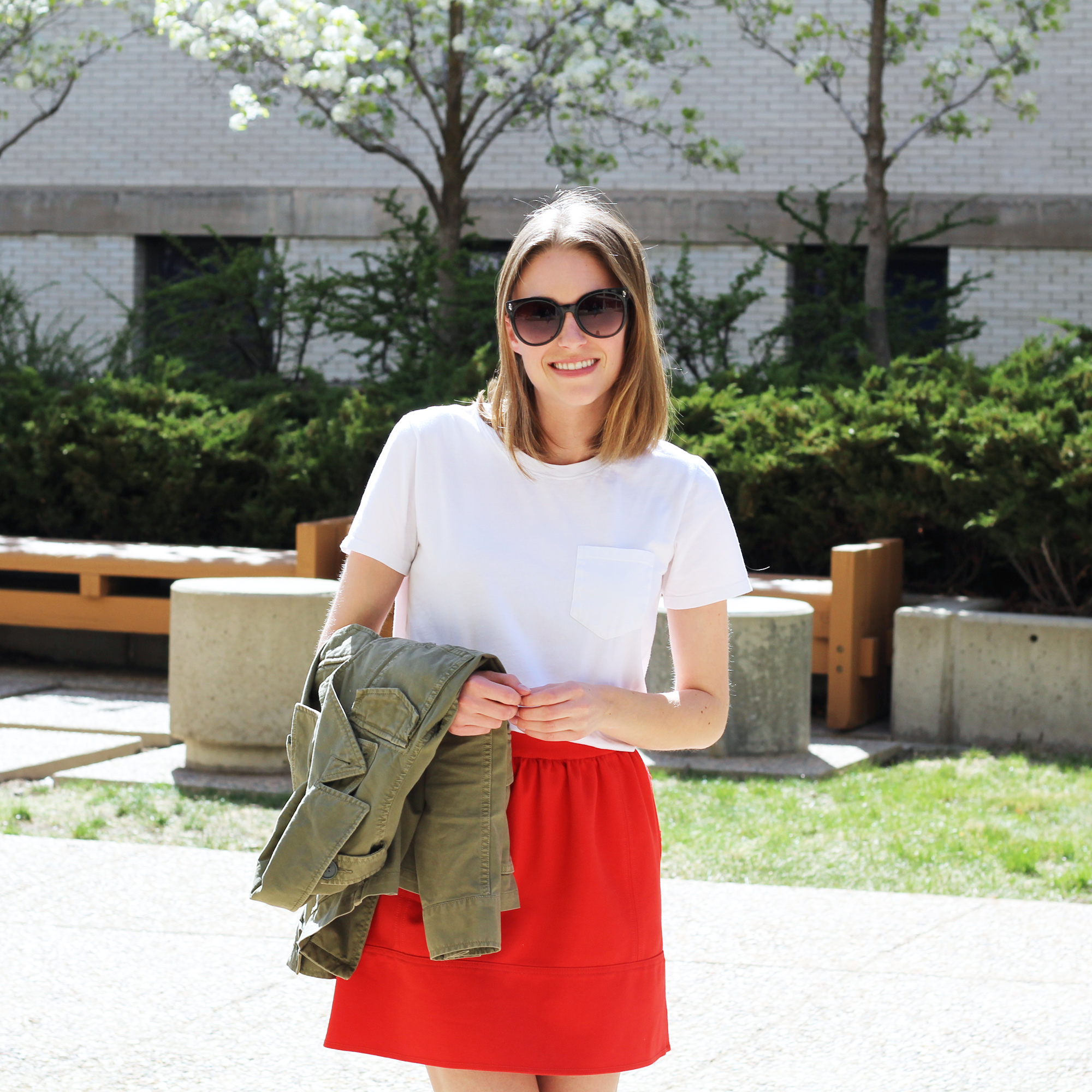 White Everlane box tee + red mini skirt + army green utility jacket — Cotton Cashmere Cat Hair