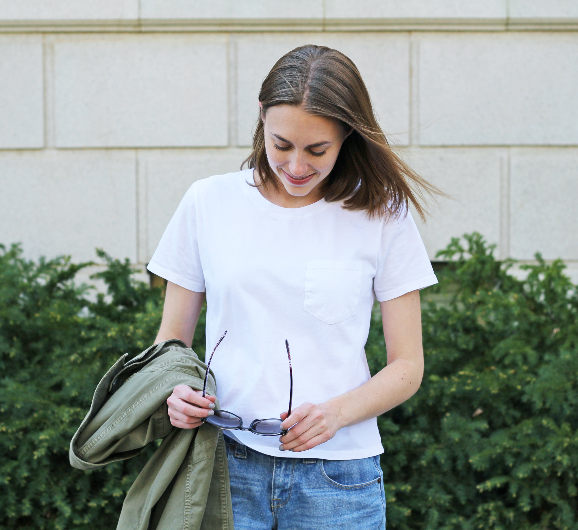 Everlane white box tee, denim short, olive green Madewell 'Outbound' jacket — Cotton Cashmere Cat Hair