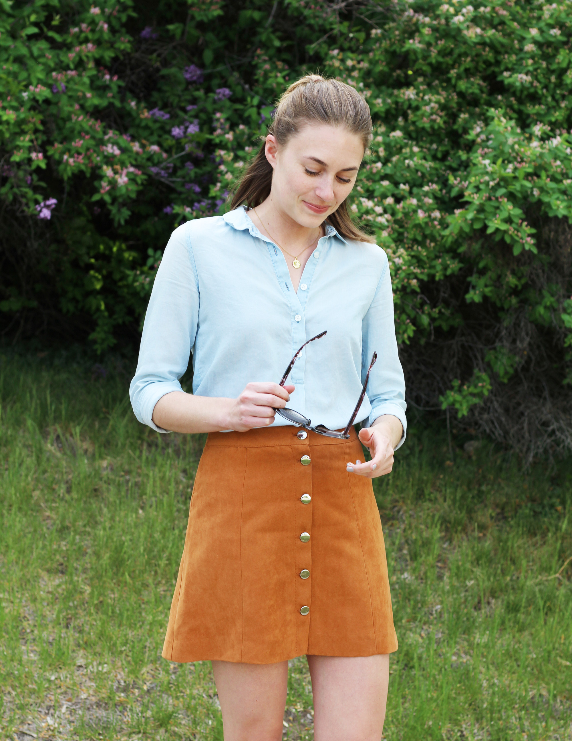 Light blue shirt + tan button-front skirt — Cotton Cashmere Cat Hair