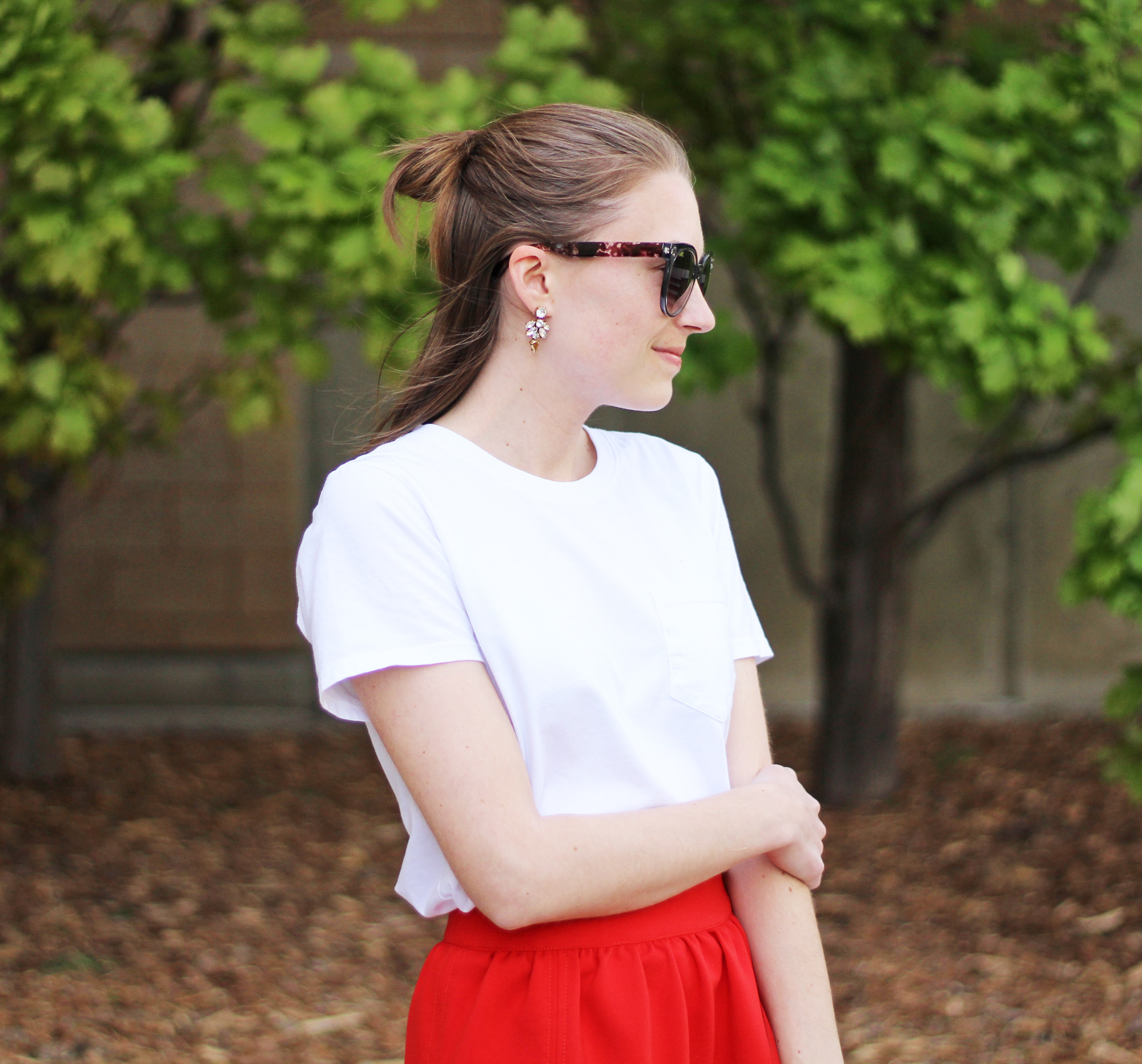 Statement earrings + white Everlane tee + red skirt — Cotton Cashmere Cat Hair