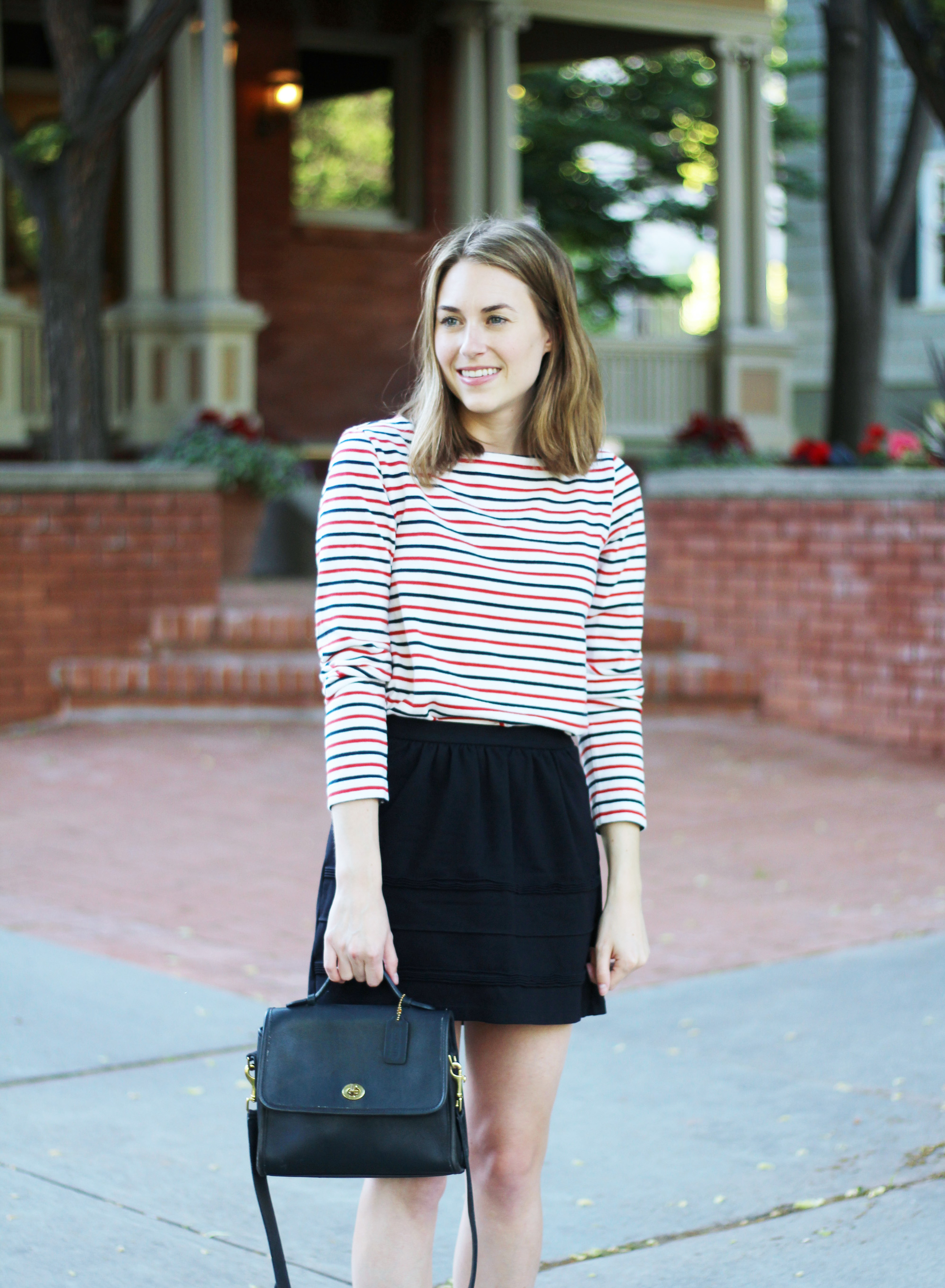 Navy and red striped tee + black skirt + navy Coach 'Court' bag — Cotton Cashmere Cat Hair