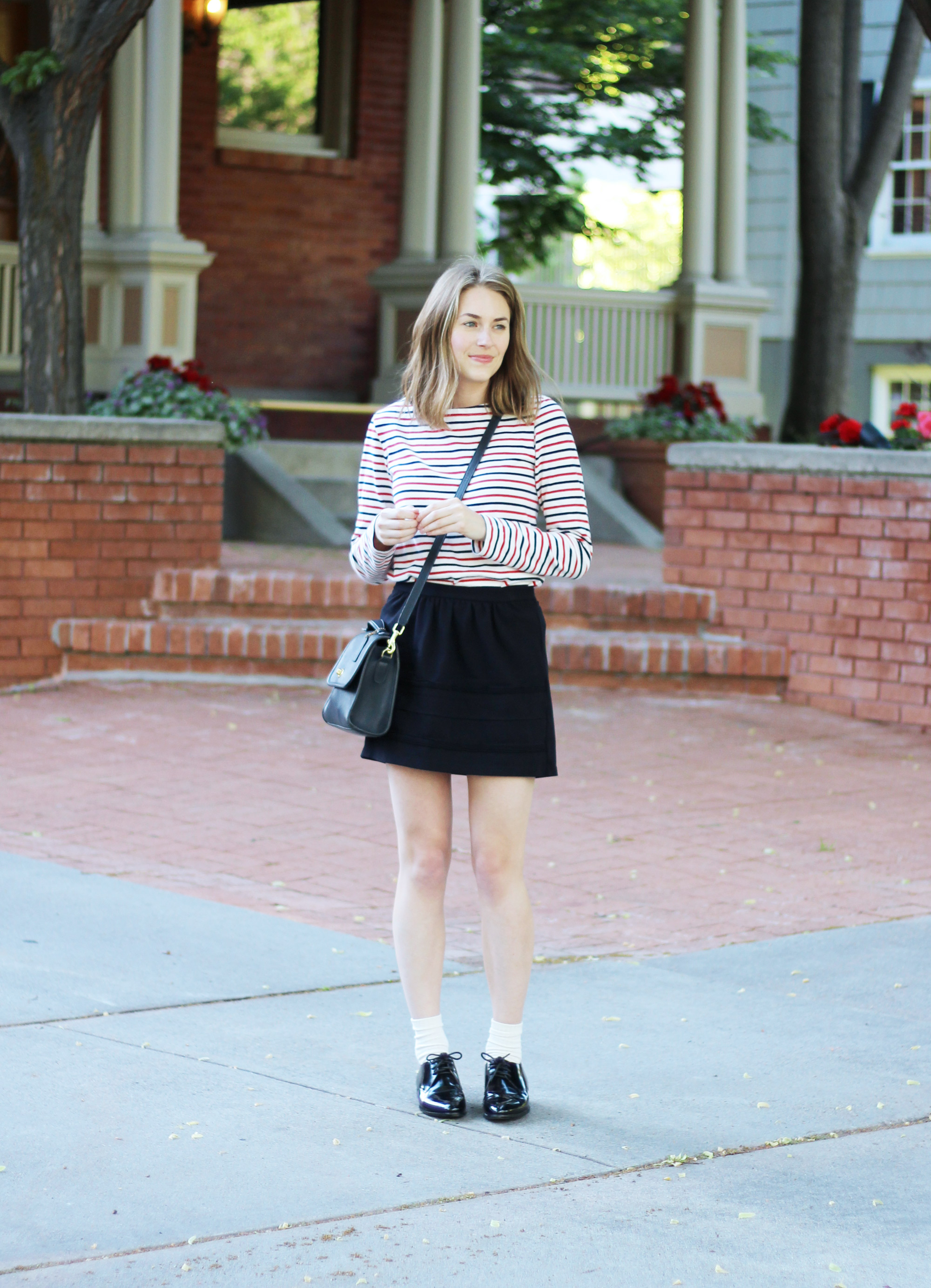 Navy and red striped tee, black mini skirt, navy Coach bag, shiny black oxfords — Cotton Cashmere Cat Hair