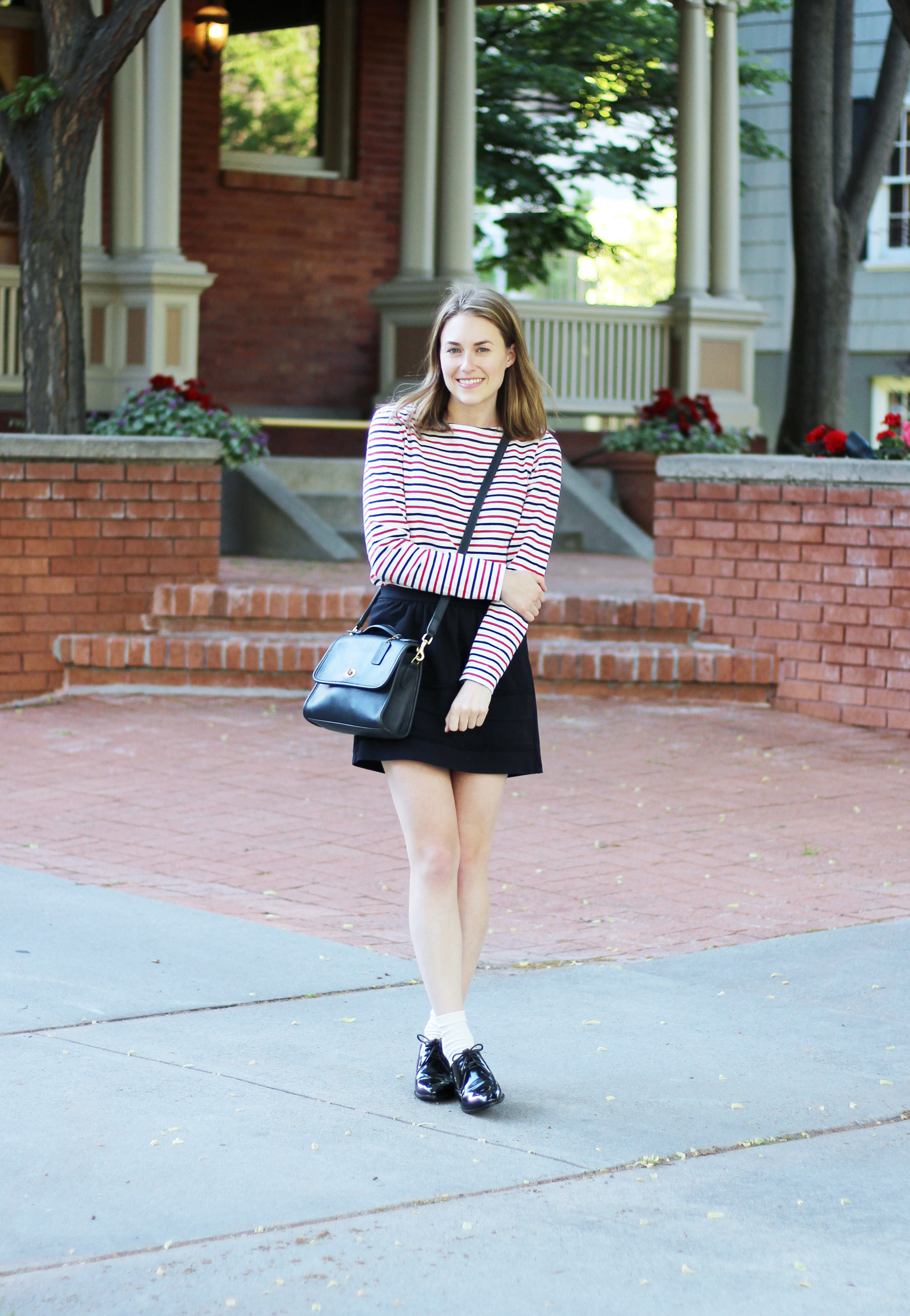 Navy and red striped tee outfit with black mini skirt, shiny black oxfords, and navy Coach bag — Cotton Cashmere Cat Hair