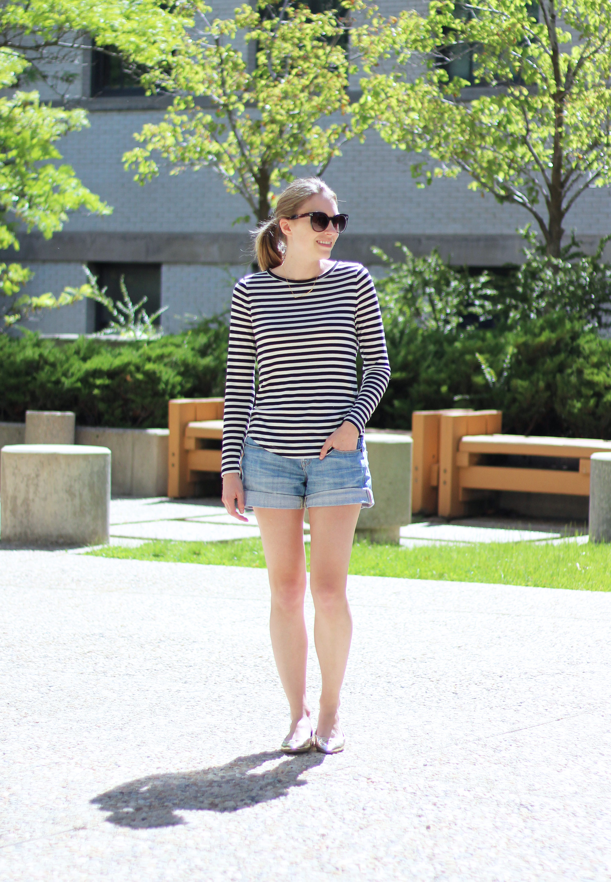 Striped tee outfit with denim shorts and metallic gold flats — Cotton Cashmere Cat Hair
