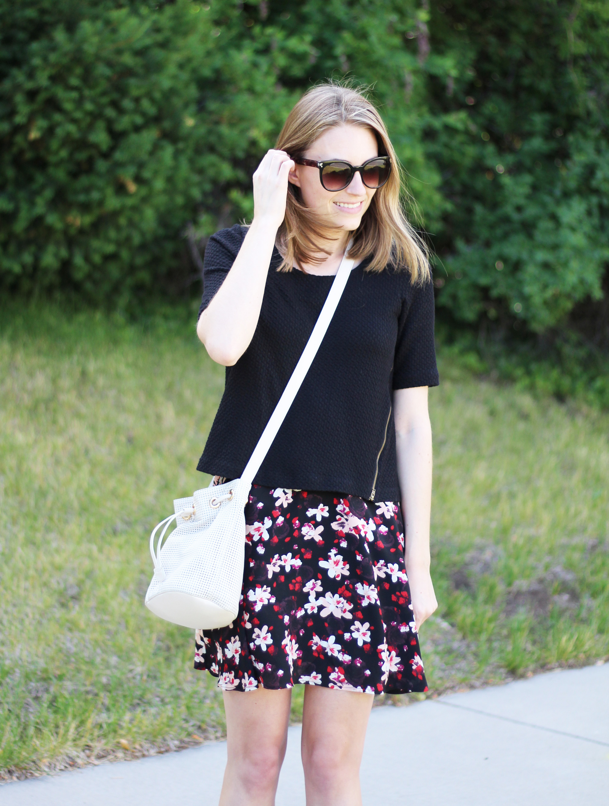 Dark floral skirt outfit with black cropped top and white bucket bag — Cotton Cashmere Cat Hair