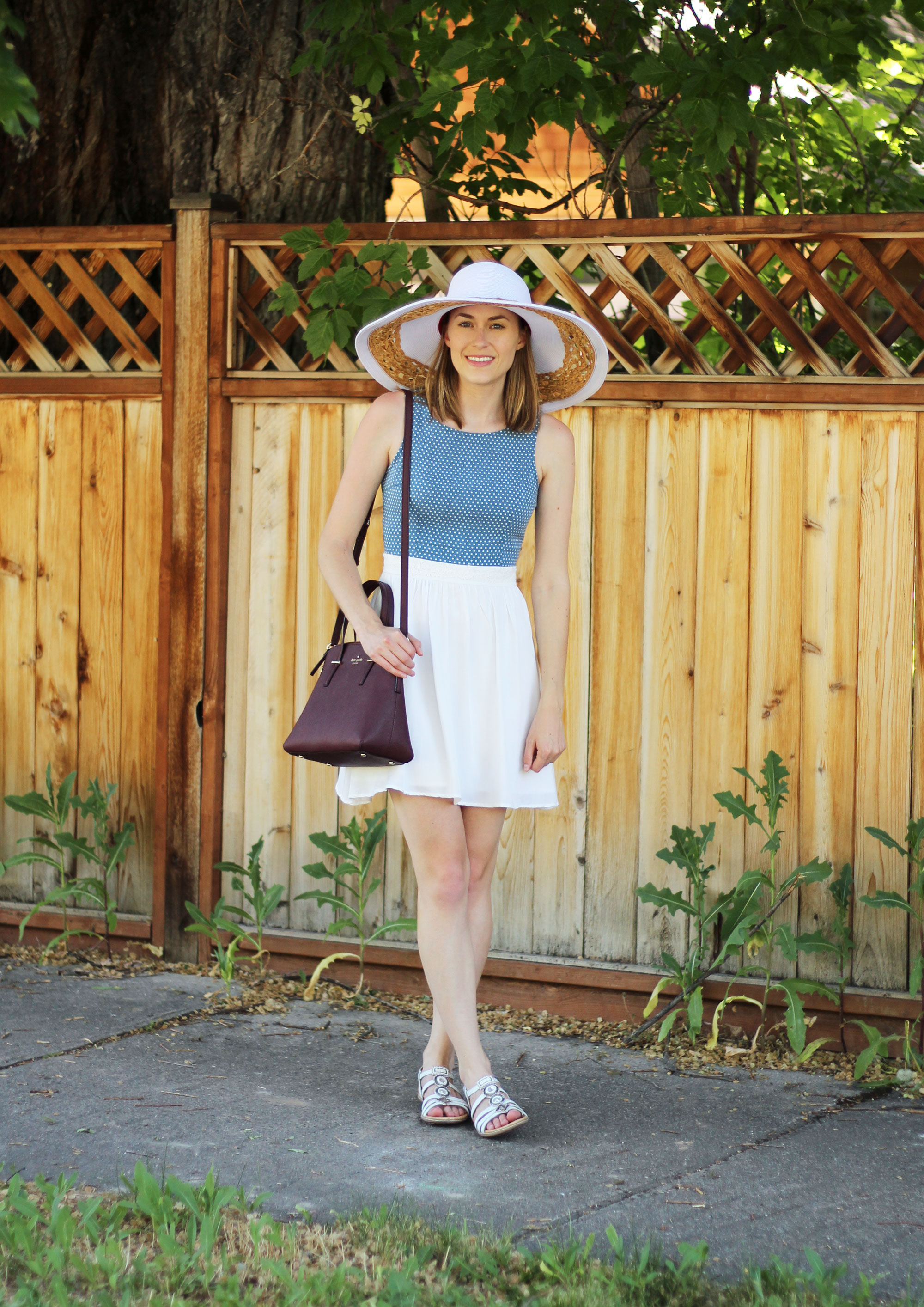 Blue and white sundress, white sandals, white sun hat, burgundy bag — Cotton Cashmere Cat Hair