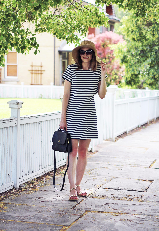 Navy striped dress, straw sun hat, navy Coach bag, gold sandals — Cotton Cashmere Cat Hair