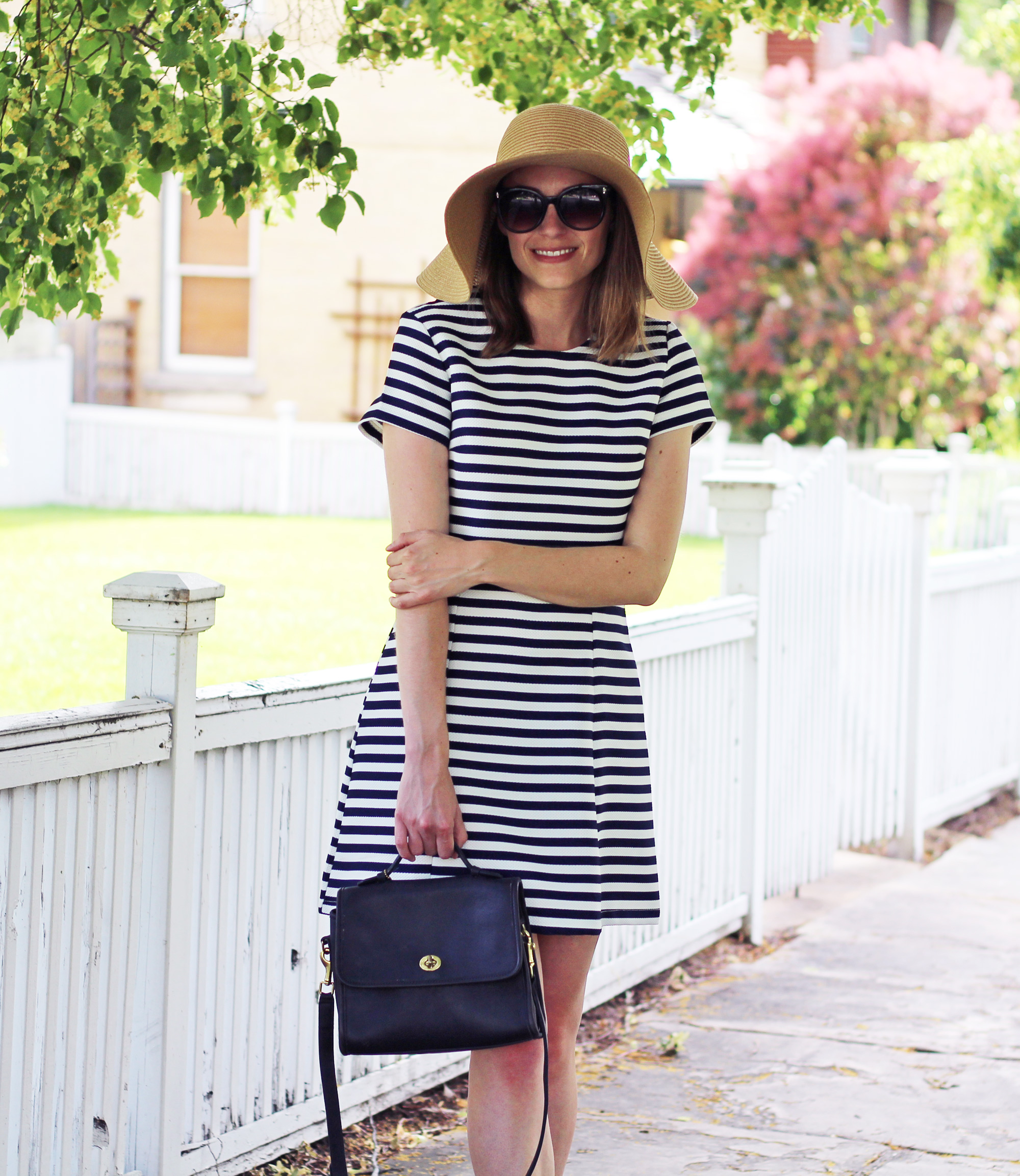 Floppy sun hat + navy striped dress + navy Coach bag — Cotton Cashmere Cat Hair