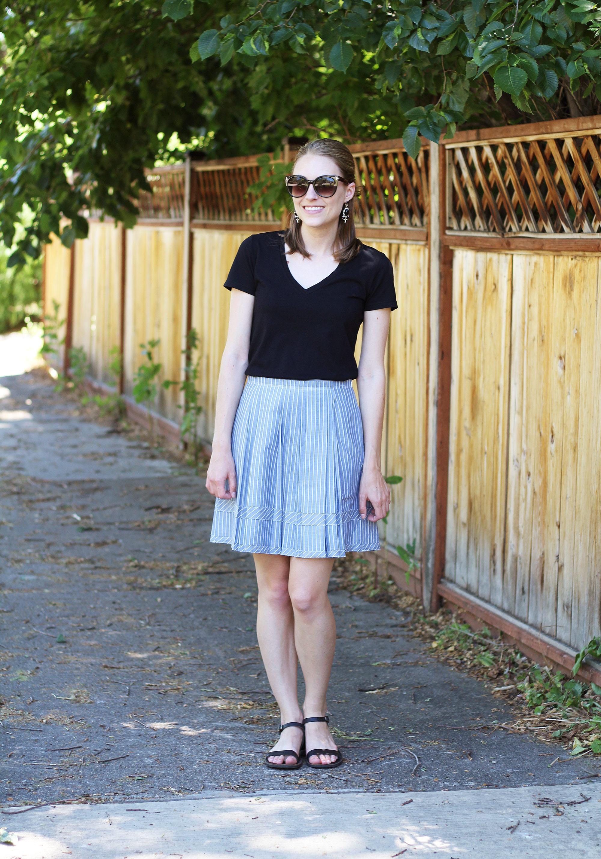 Black tee, blue Madewell shirtstripe skirt, black sandals, statement earrings — Cotton Cashmere Cat Hair