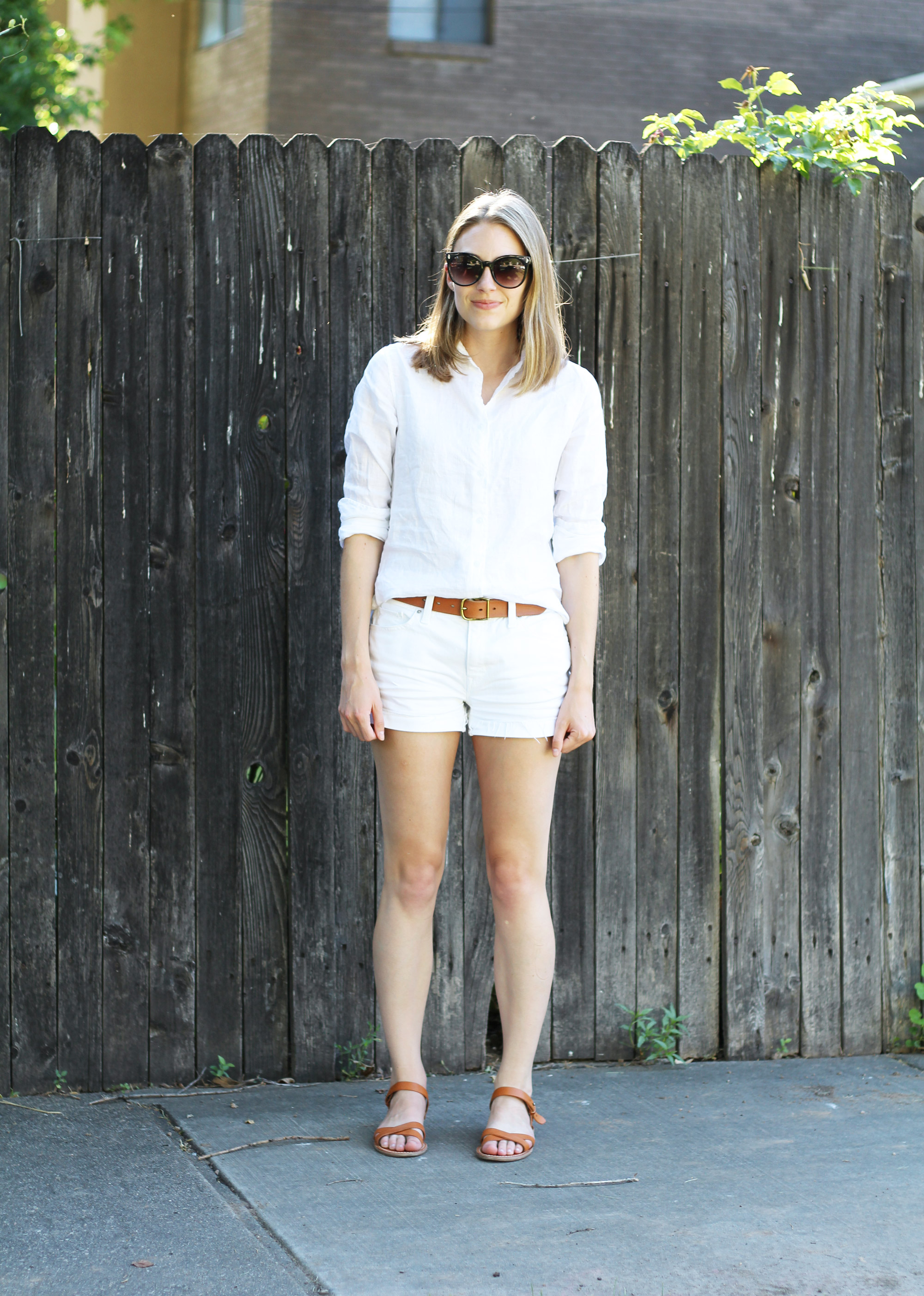 White linen shirt outfit with white shorts, cognac belt, and cognac sandals — Cotton Cashmere Cat Hair