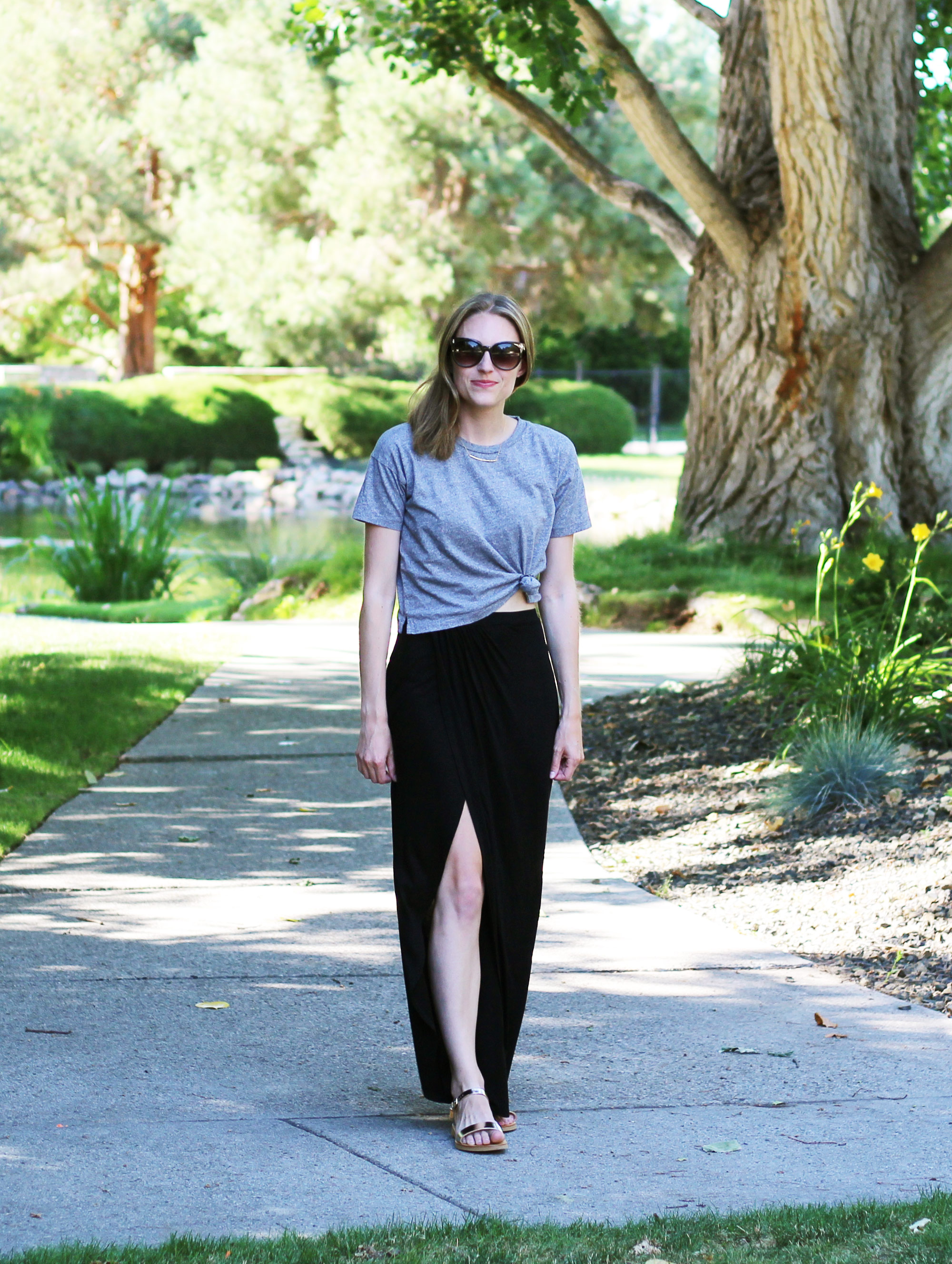 Black maxi skirt outfit with tied cropped tee and gold sandals — Cotton Cashmere Cat Hair