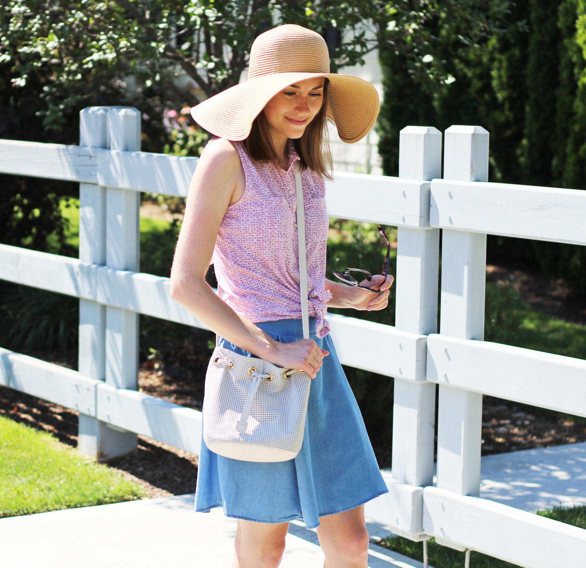 Red floral shirt with chambray skirt, white bucket bag, and floppy sun hat — Cotton Cashmere Cat Hair