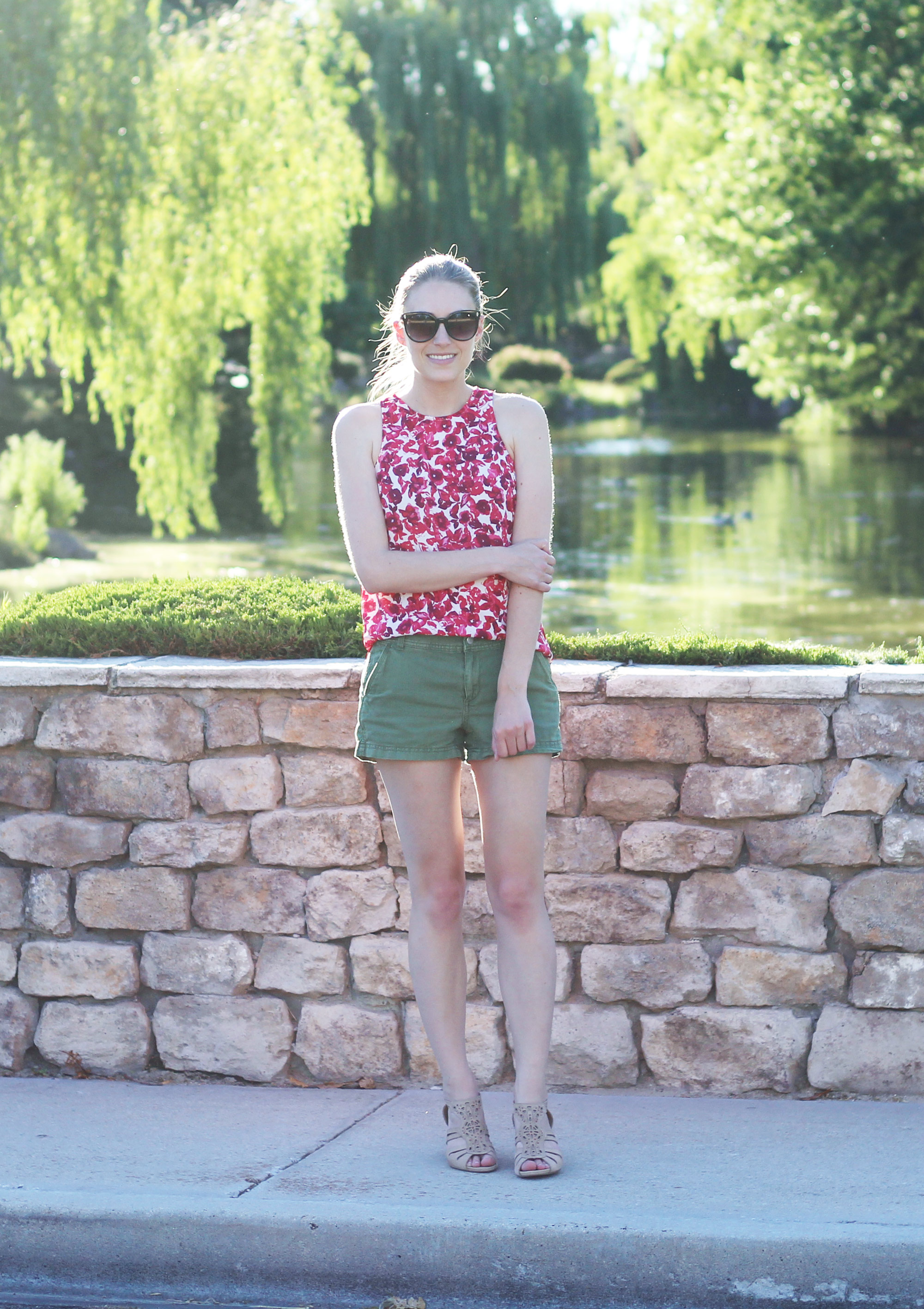 Who What Wear red floral tank top outfit with green shorts and beige sandals — Cotton Cashmere Cat Hair