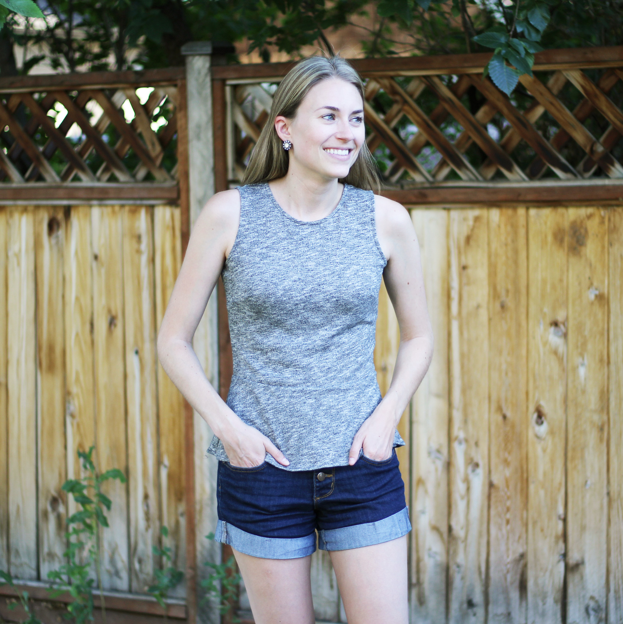 Grey peplum top outfit with high-rise shorts — Cotton Cashmere Cat Hair