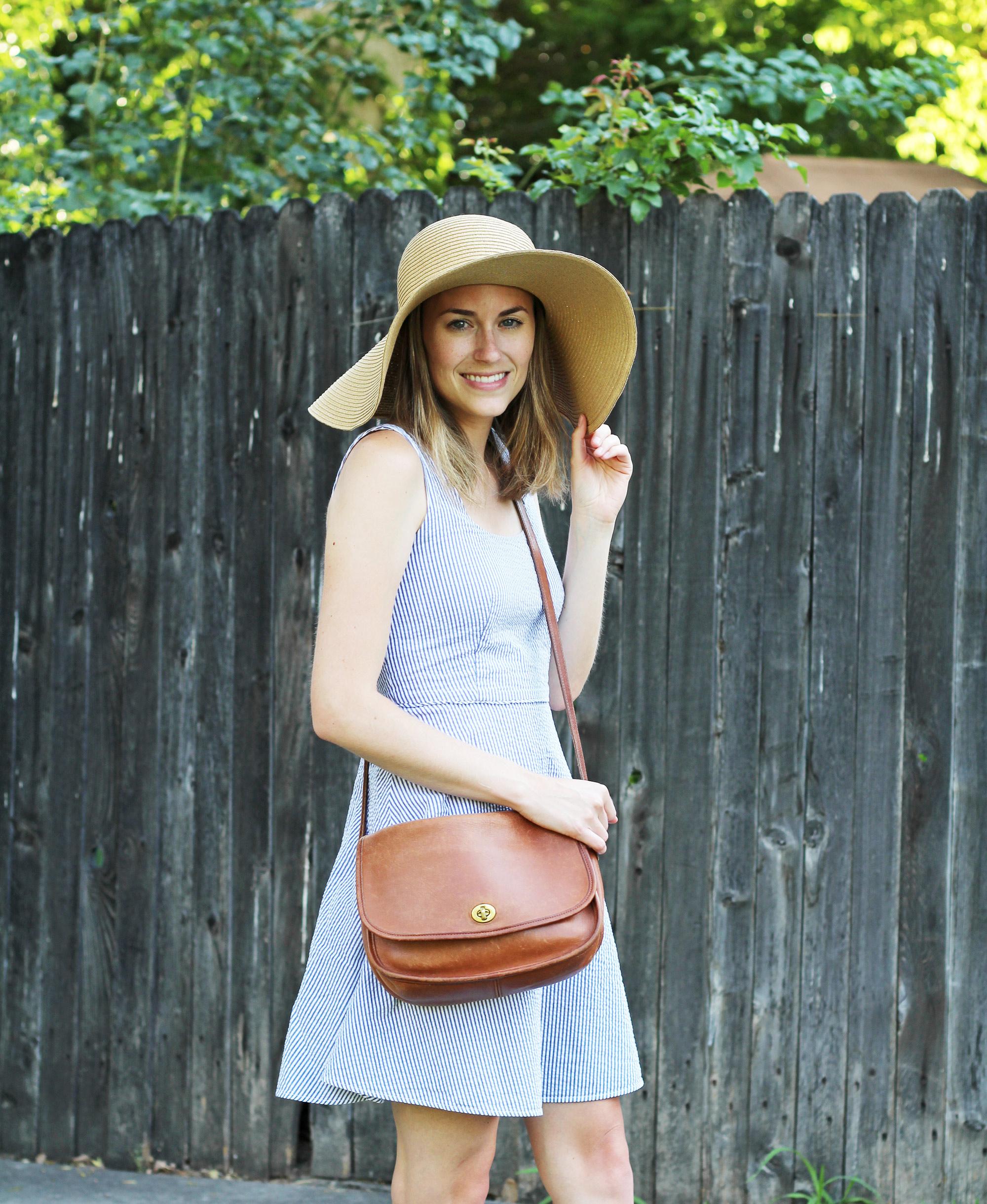 Seersucker dress outfit with floppy sun hat and cognac Coach bag — Cotton Cashmere Cat Hair