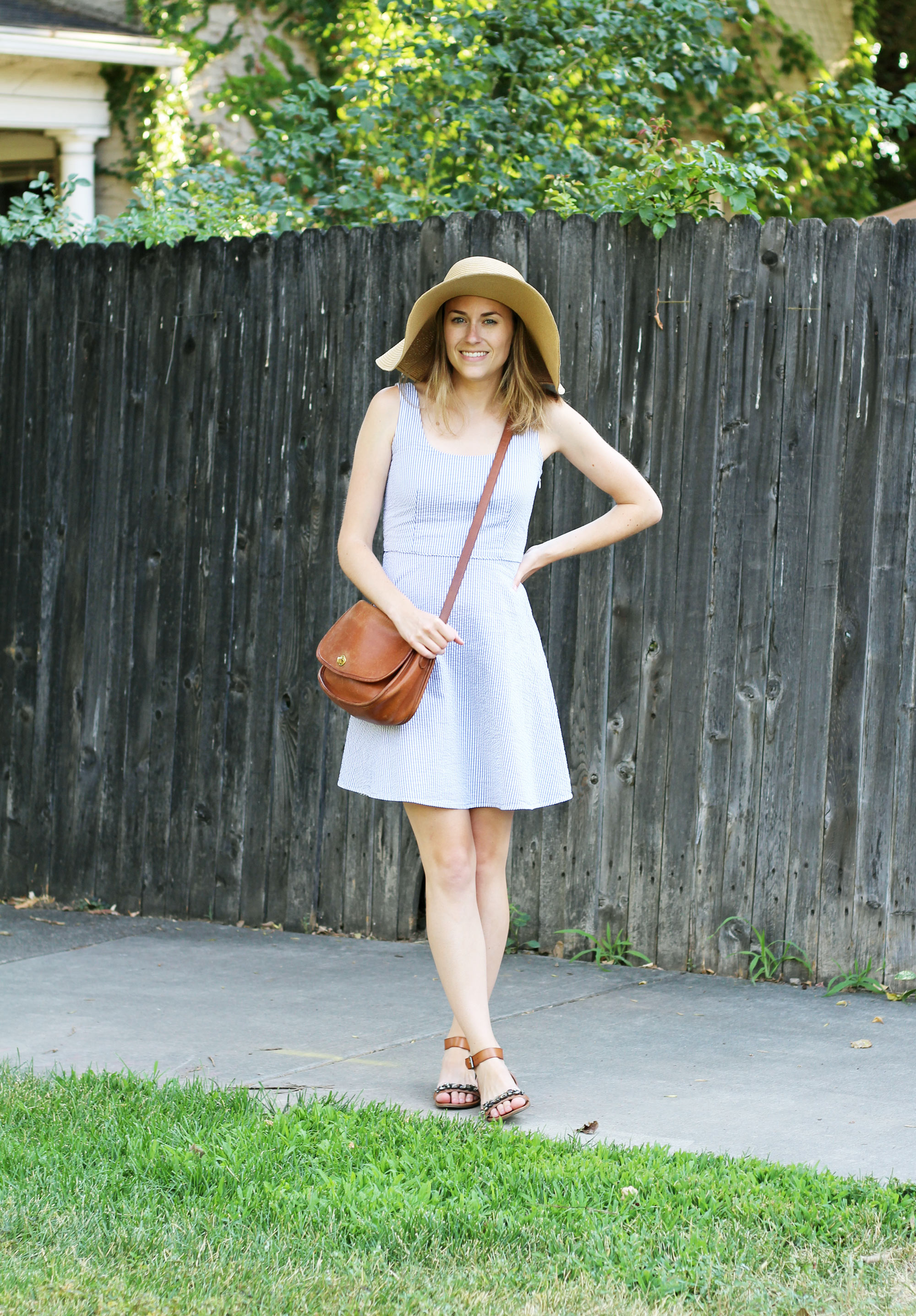 Seersucker dress outfit with embellished sandals, floppy sun hat, and cognac Coach bag — Cotton Cashmere Cat Hair