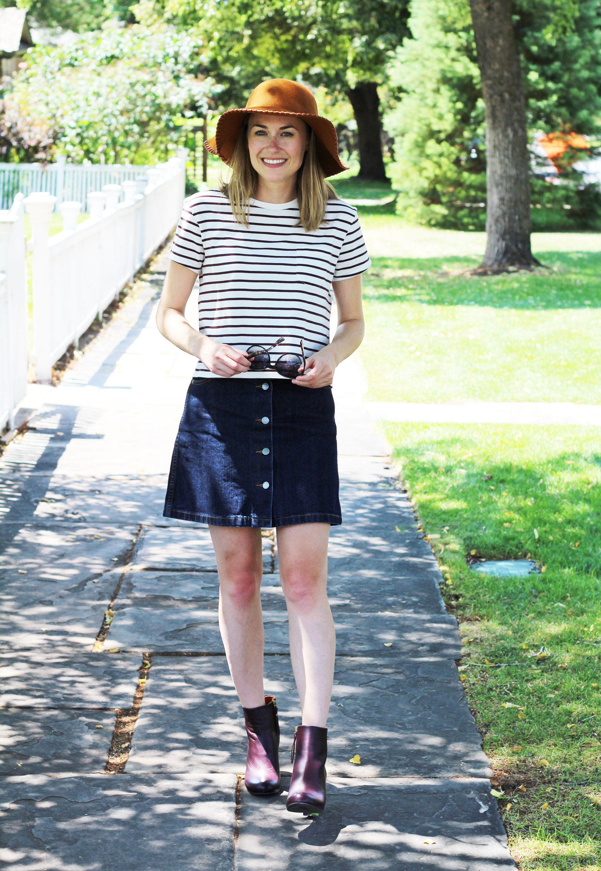 Denim skirt outfit with burgundy striped tee, burgundy ankle boots, and rust floppy hat — Cotton Cashmere Cat Hair