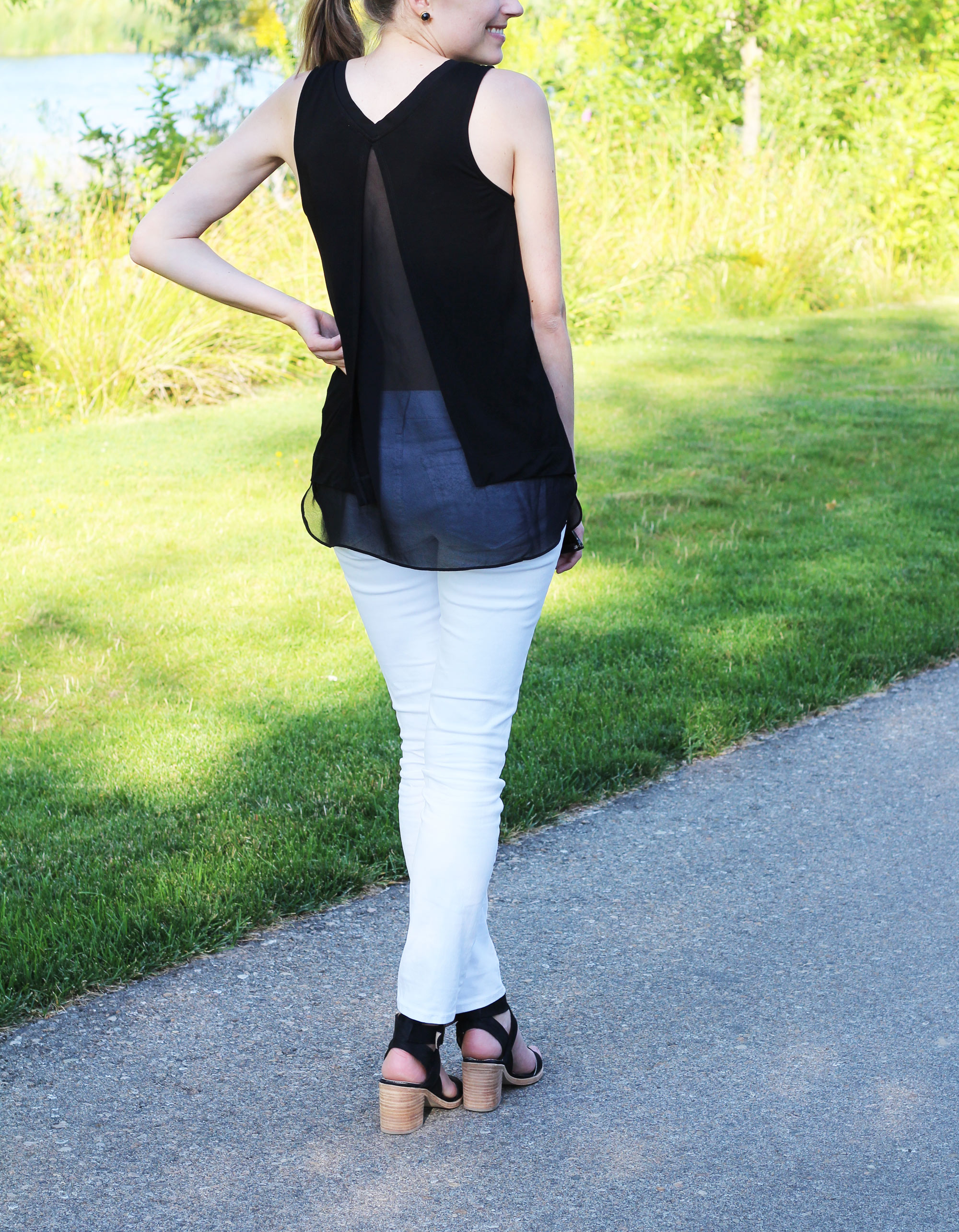 Trouve mixed media layered tank top with white skinny jeans and black sandals — Cotton Cashmere Cat Hair