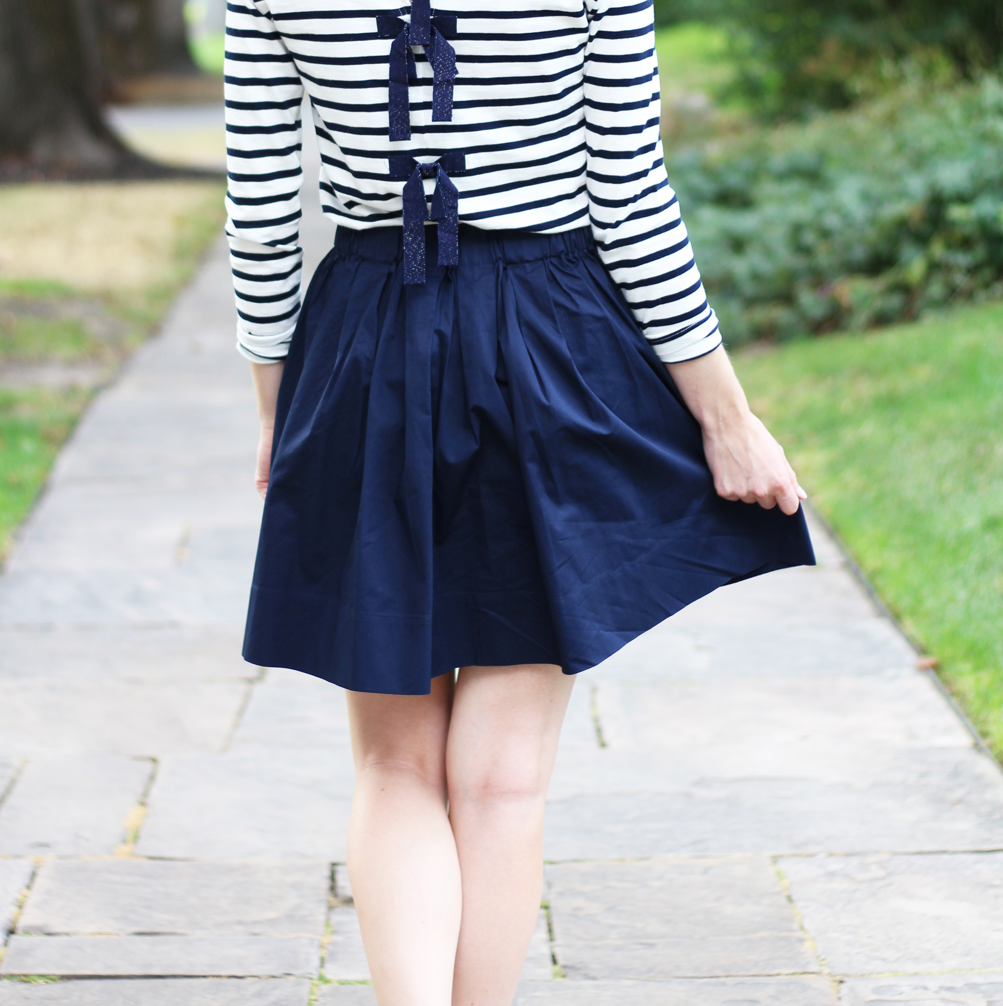 Navy striped tee with bows + navy Everlane skirt — Cotton Cashmere Cat Hair