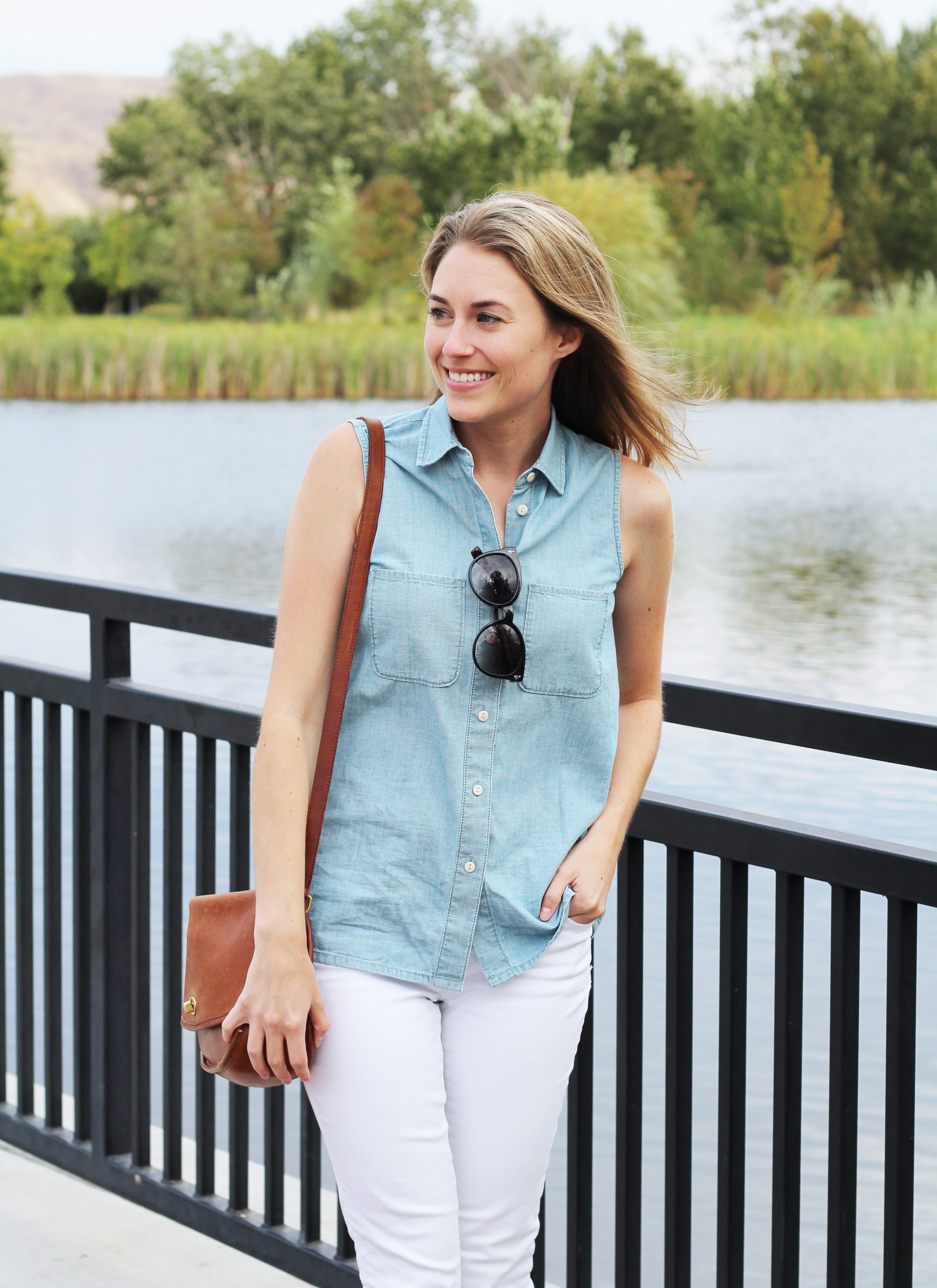 Sleeveless chambray shirt outfit with white jeans and Coach 'City' bag — Cotton Cashmere Cat Hair