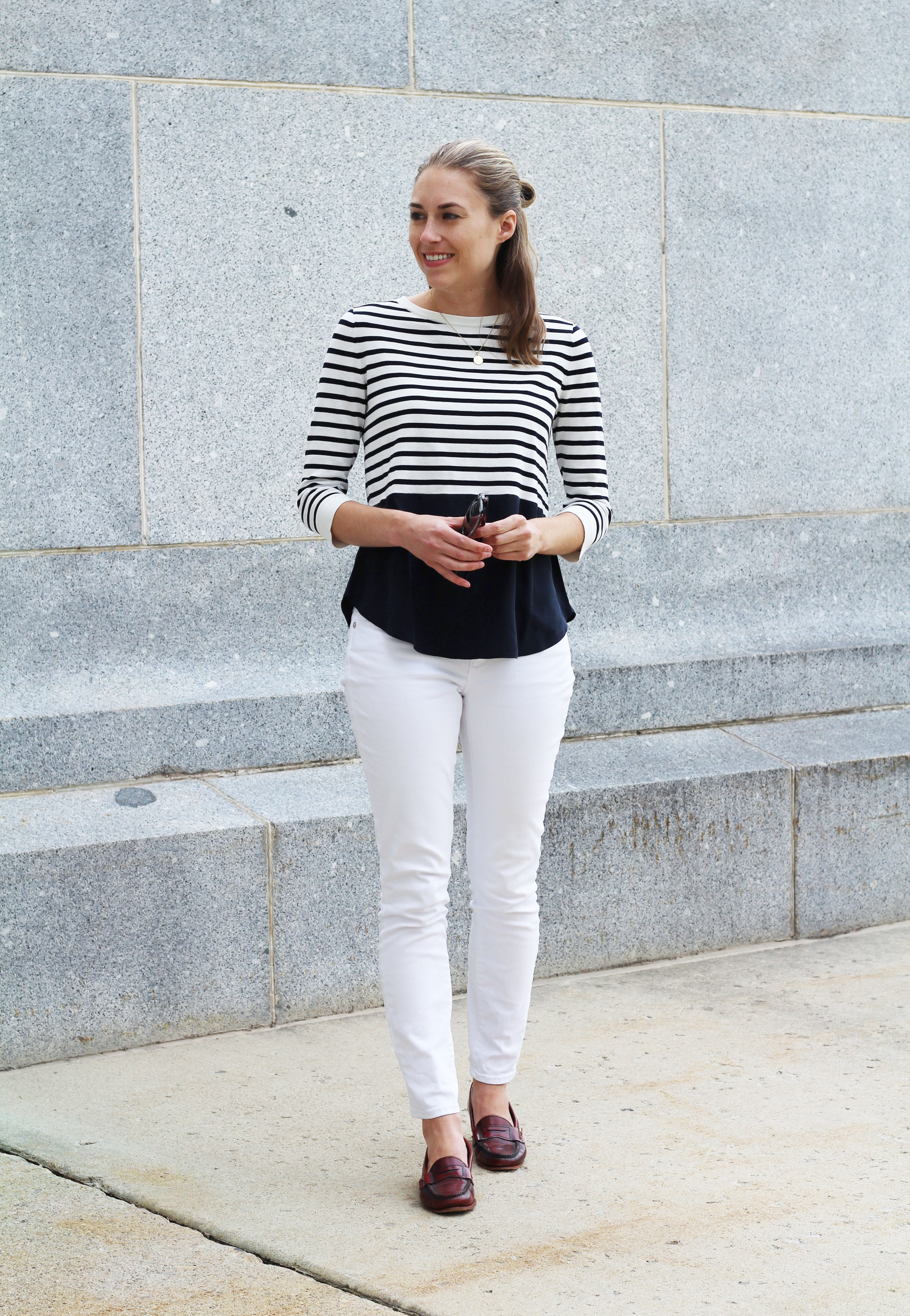 Nautical-inspired fall outfit with navy stripes, white skinny jeans, and burgundy loafers — Cotton Cashmere Cat Hair